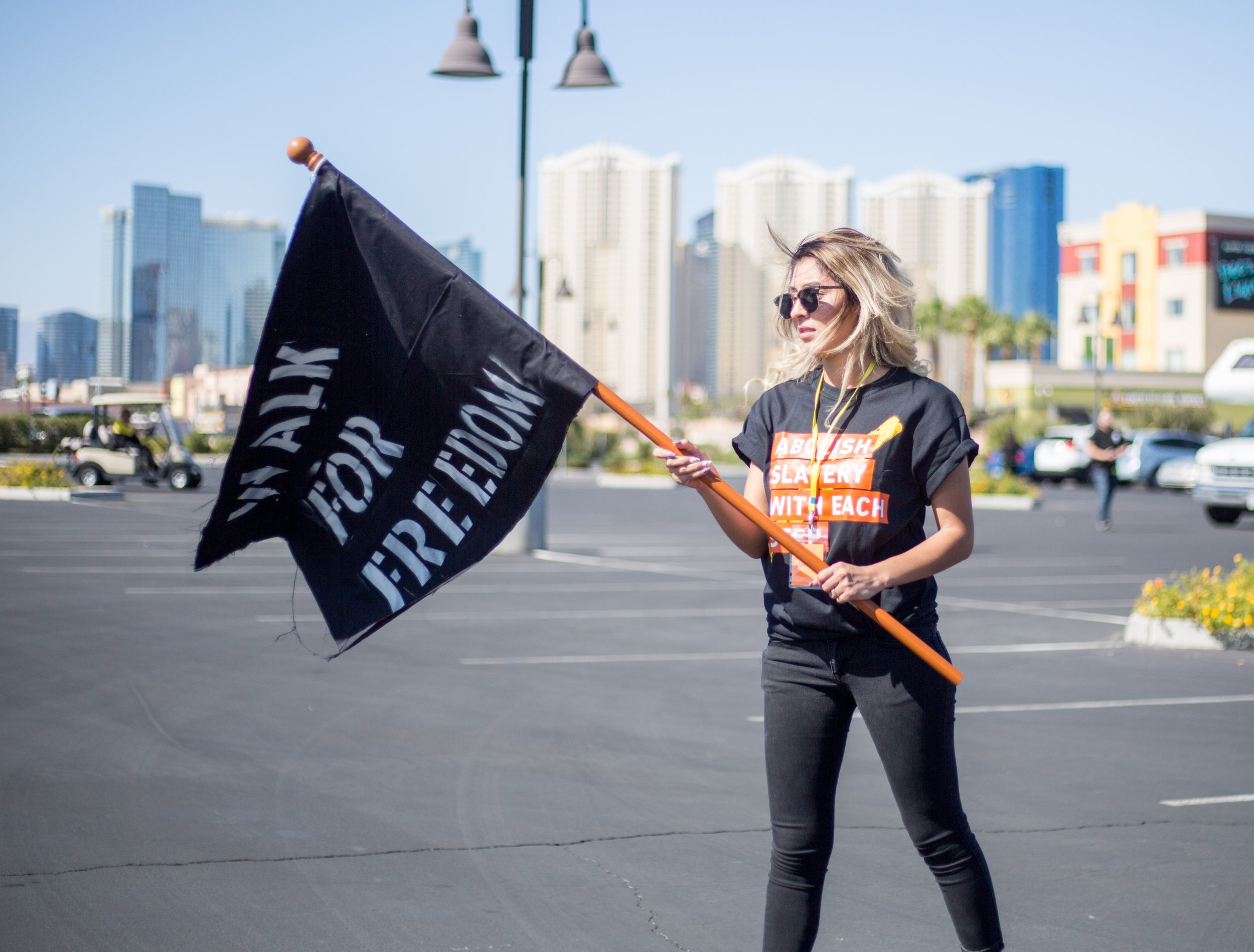 Woman Holding Walk for Freedom Flag