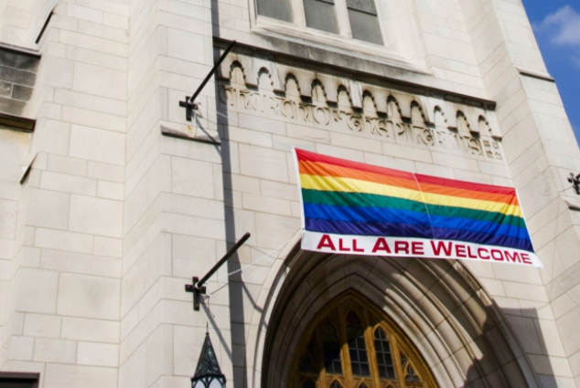 All Are Welcome Flag in Church Entrance