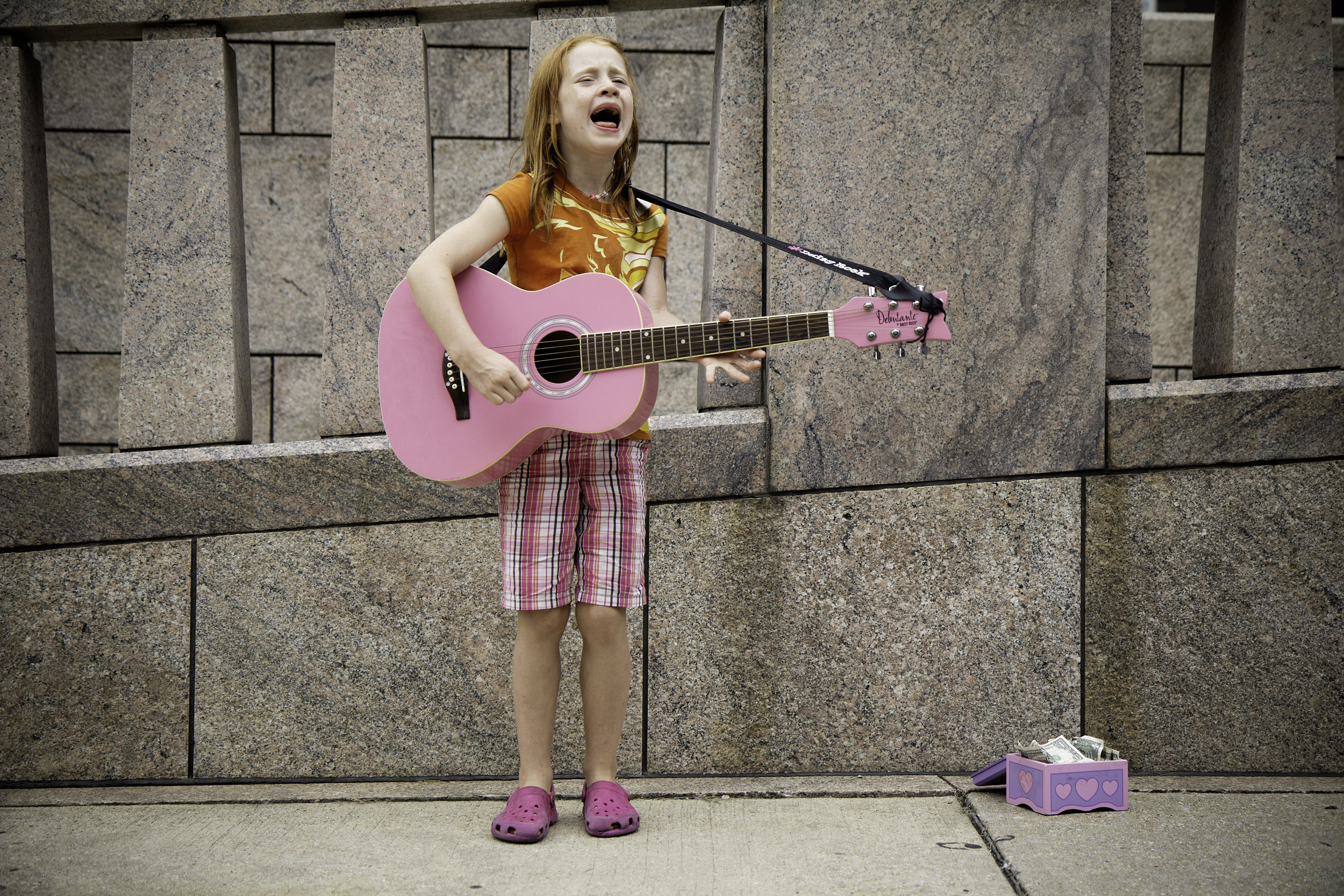 Singing little girl in pink.