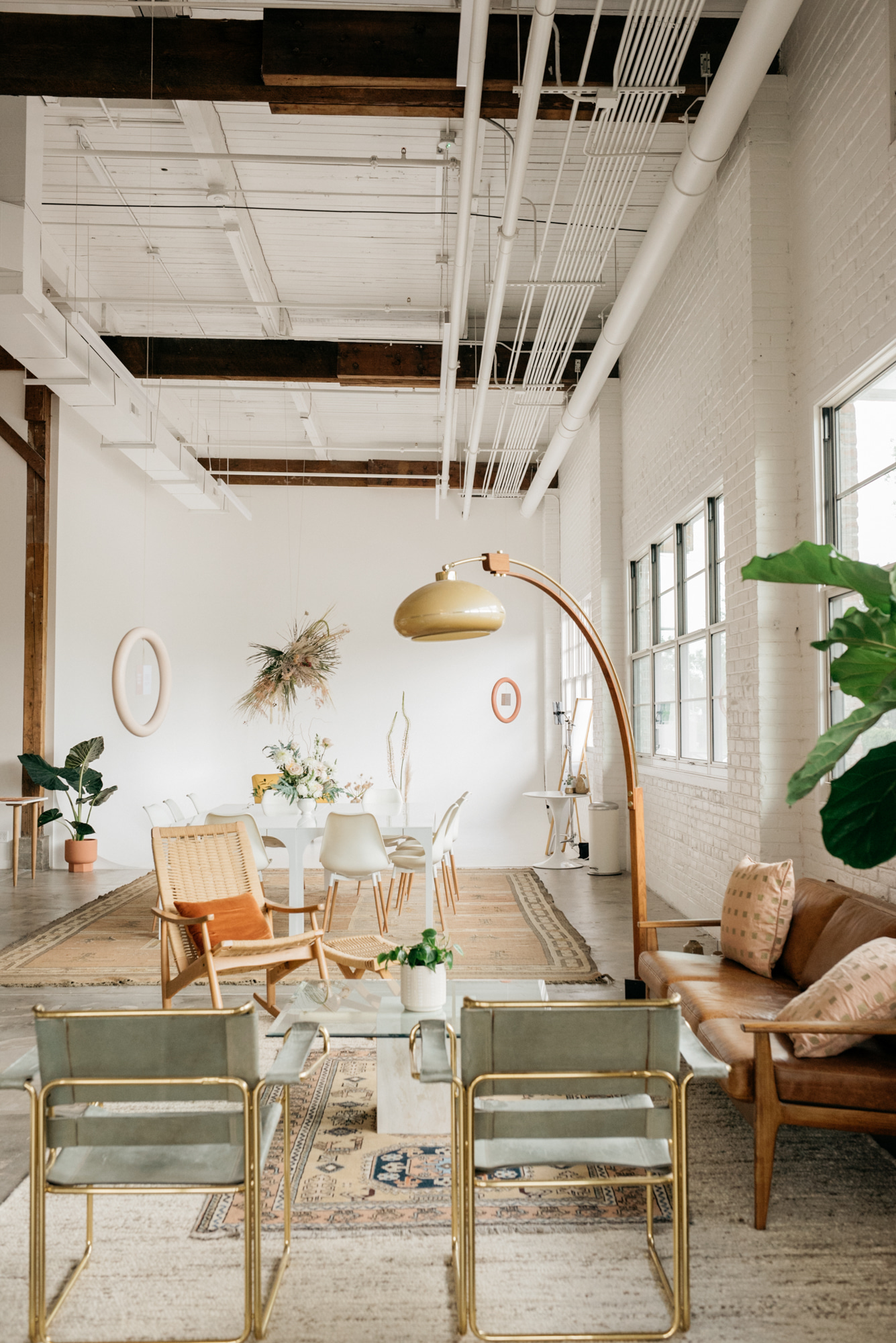 Cozy Interior Work Space With White Walls and High Ceilings