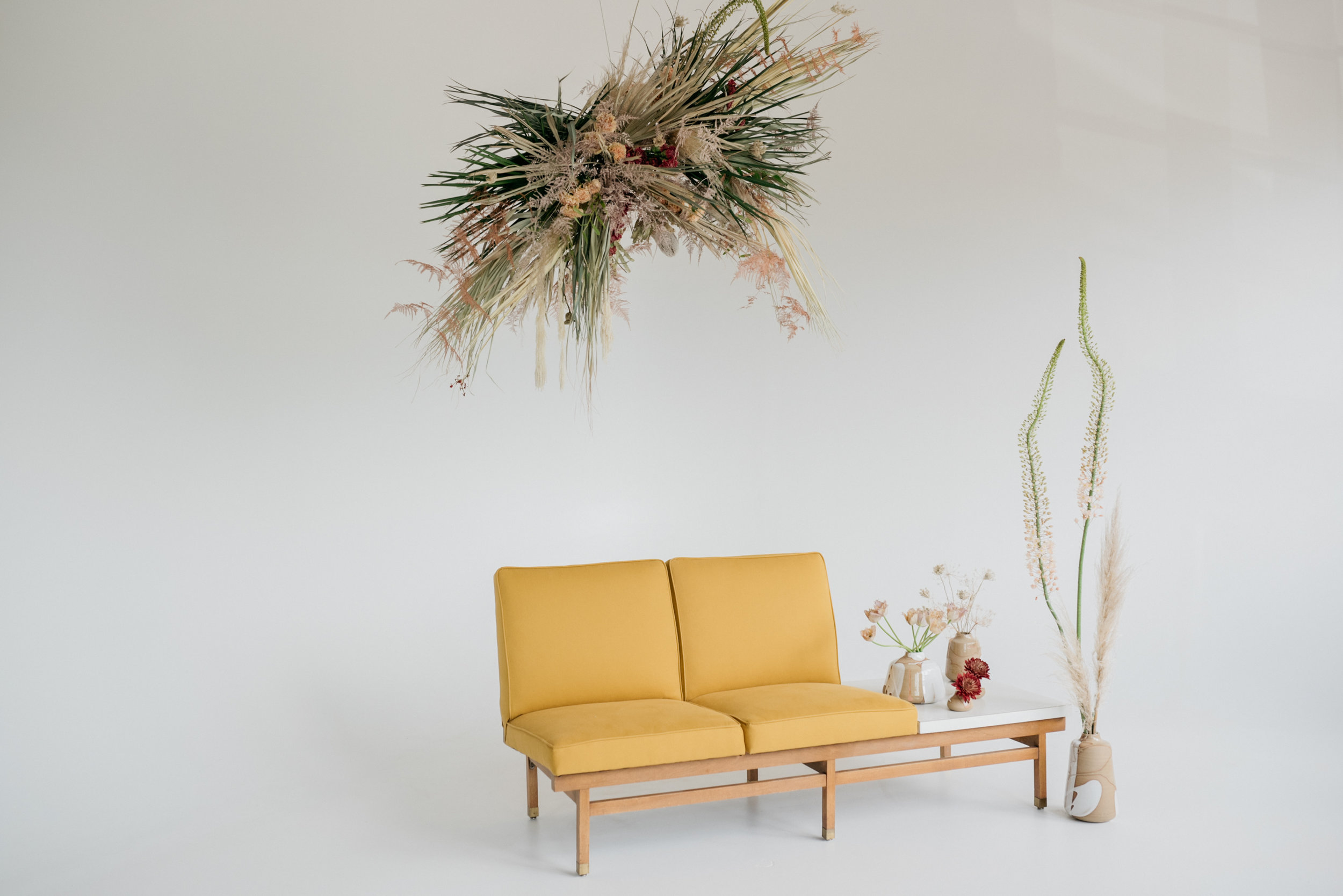 Floral installation by  Pickle Town Floral  & Sofa sourced by  Meek Vintage