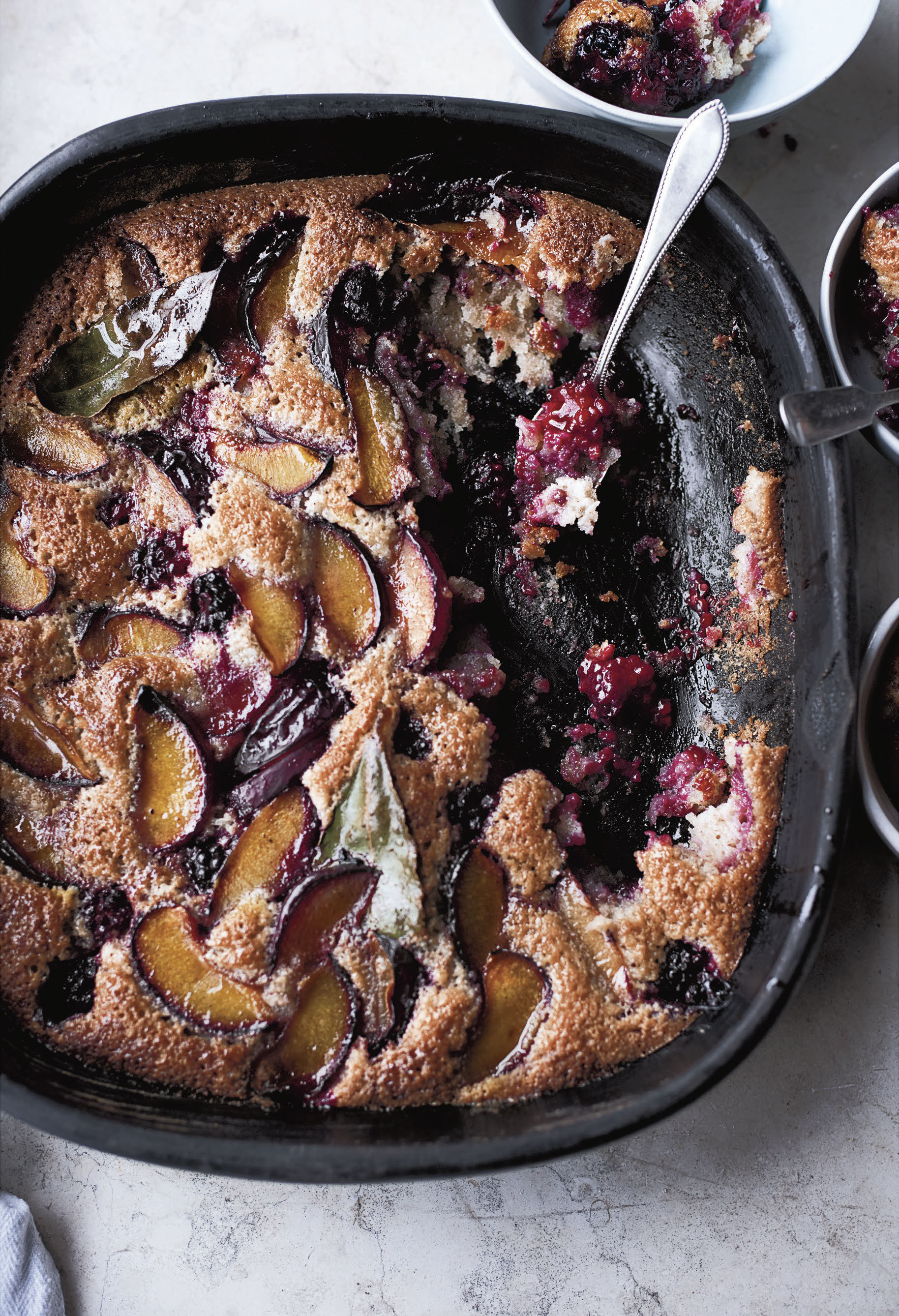 OTTOLENGHI SIMPLE_Plum, Blackberry, and Bay Friand.jpg