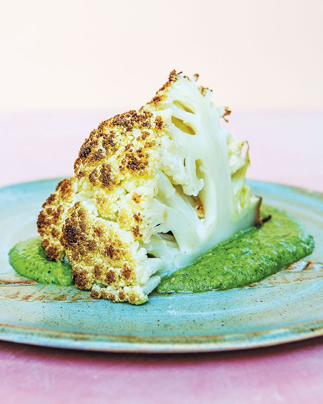 "The Whole Roasted Cauliflower with Green Pea Chutney in @pkgourmet's Indian-ish has its roots in another cookbook.⁣⁣⁣ ⁣⁣⁣⁣ ⁣""This recipe goes all the way back to 1980, when my mom and dad got married and bought their first cookbook, The Pleasures of Vegetarian Cooking, by the iconic and prolific Indian food writer Tarla Dalal,"" Priya writes. ""The chutney for this dish has evolved over the years as my mom has added little tweaks to make it really sing—but I'm obsessed with the current version, which is richer and heartier than your typical chutney thanks to the walnuts and peas, but still manages to taste light and bright.""⁣⁣⁣ ⁣⁣⁣⁣ ⁣(If you're not familiar with Tarla Dalal, Priya urges you to ""stop what you are doing and Google this amazing lady, who published over 100 books and is an absolute icon."")⁣⁣⁣ ⁣⁣⁣ ⁣Grab the recipe for this vegetarian showstopper at the link in our bio. #TalkCookbooks"