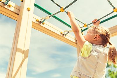 Child playing on monkey bars.jpg