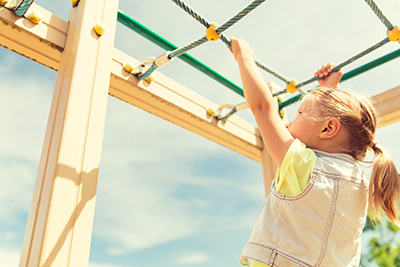 Child playing on monkey bars.jpg