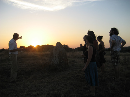 Our host Ludger pointing to the setting sun in line with the Solstice Rock.
