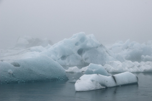 Glacier lagoon, Iceland - floating bergs in the misty atmosphere.