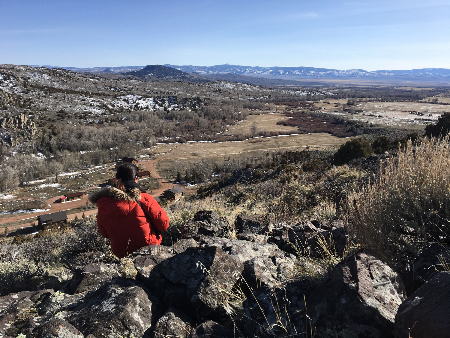My fellow artist sketching the wide open spaces from Falcon's Peak. You can see our camp below left.