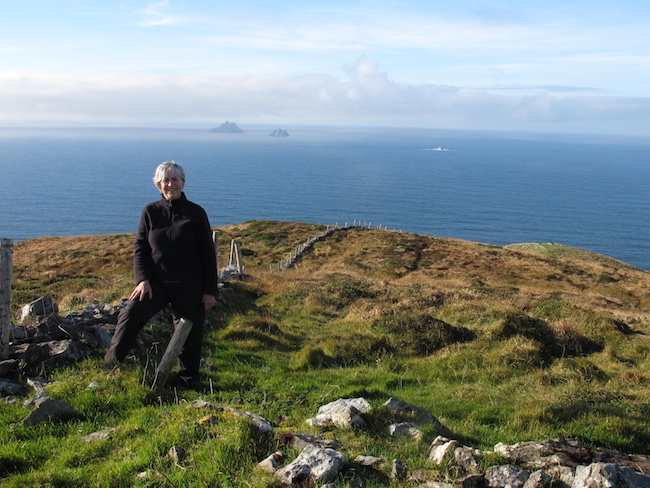 Janice Mason Steeves at Cill Rialaig Residency, with the Skelligs in the background. Ireland, 2012