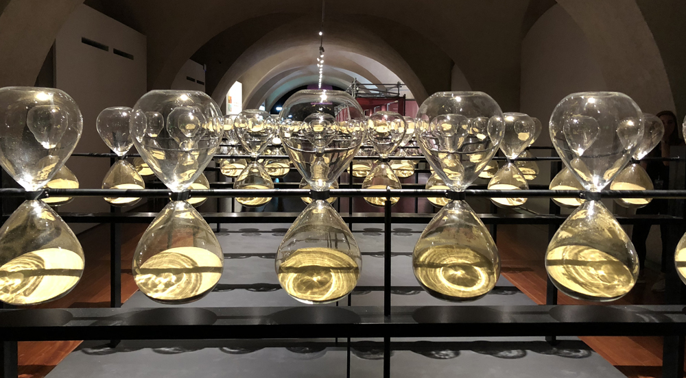 Installation of slowly rotating hour glasses at Somerset House Design Biennale, London