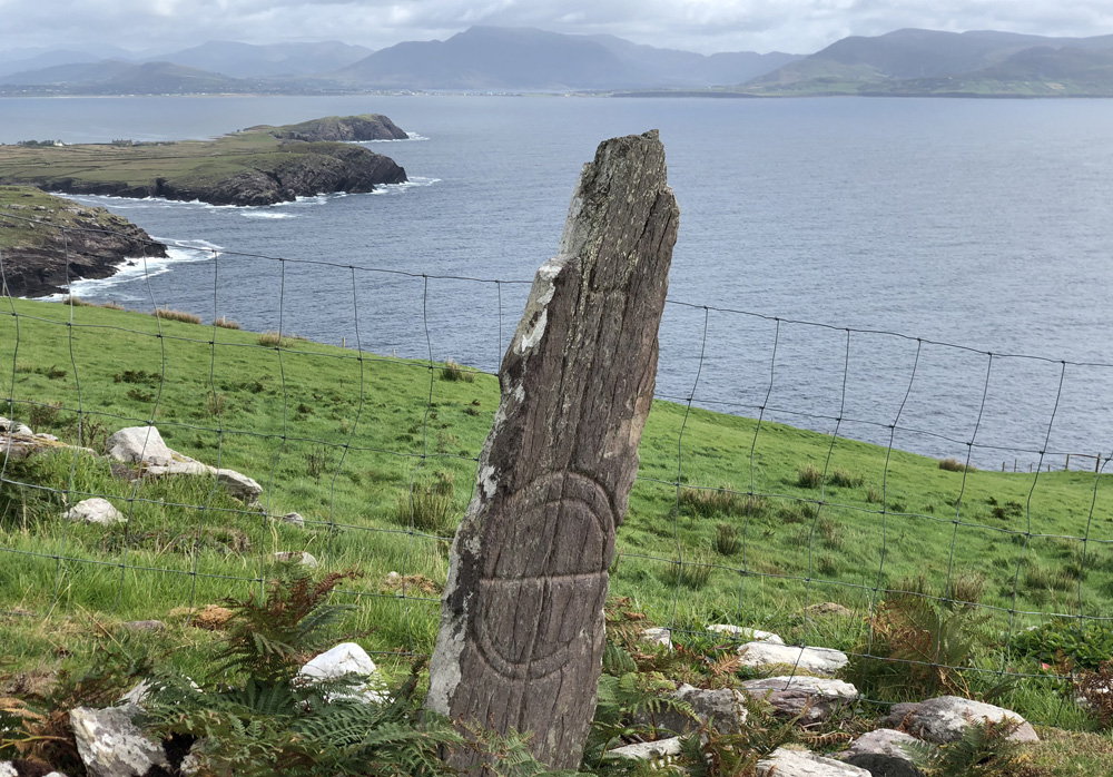 A Celtic cross carved into a standing stone.