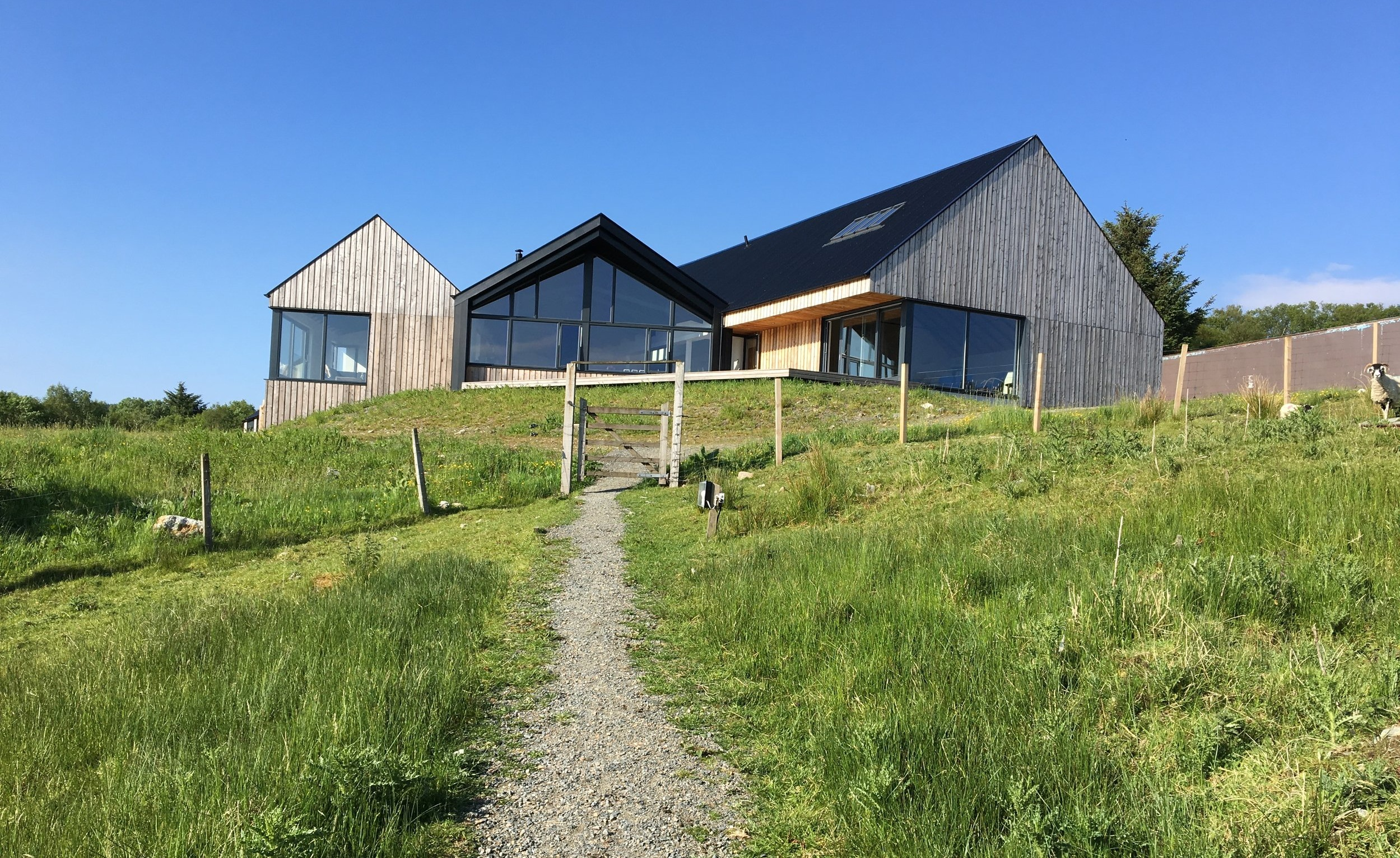 A view of the Artist's Center on a sunny day, up the path from the Pods and Cubes.