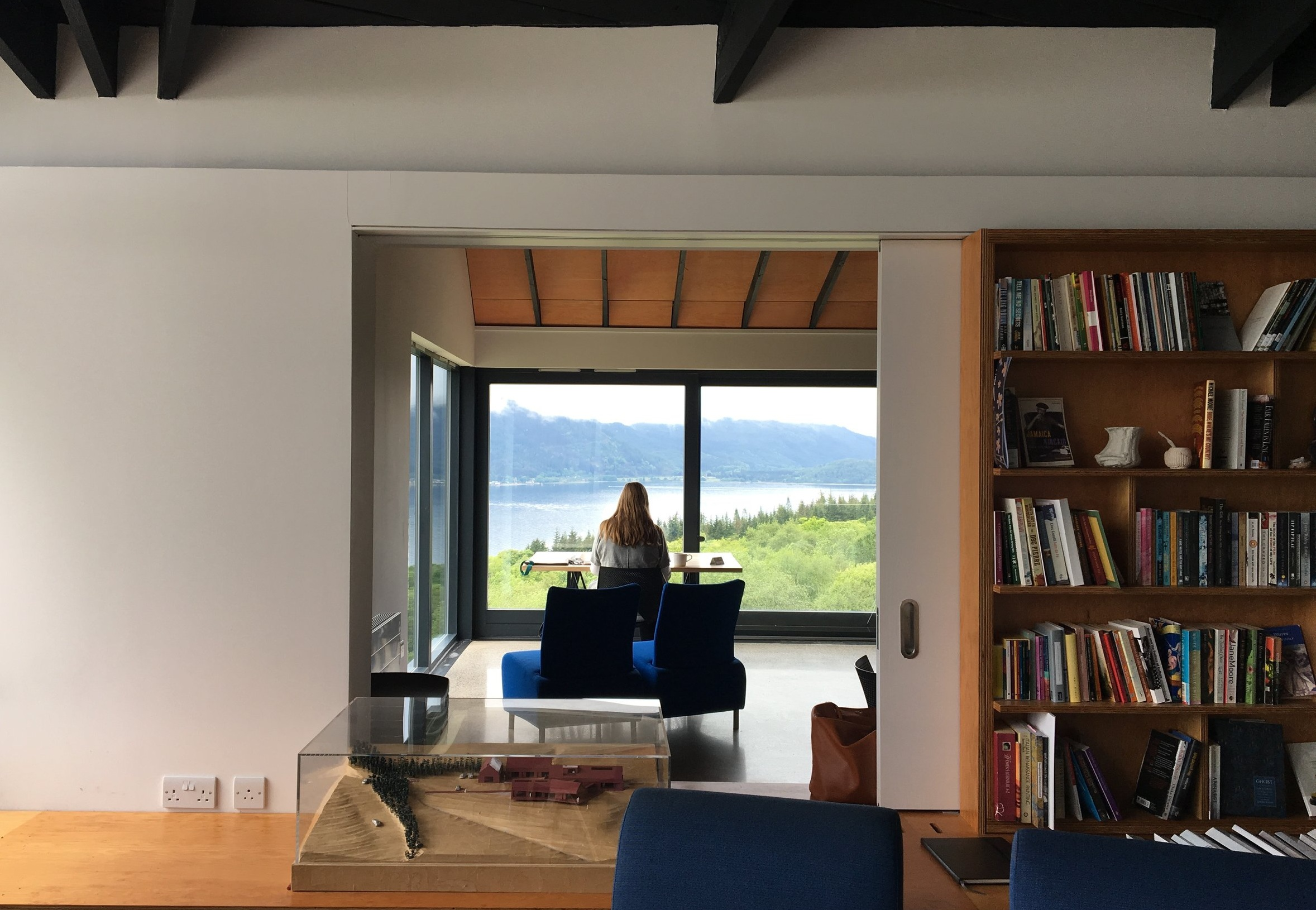 Looking through the Artist's Center meeting room to a writer's station overlooking the Loch.