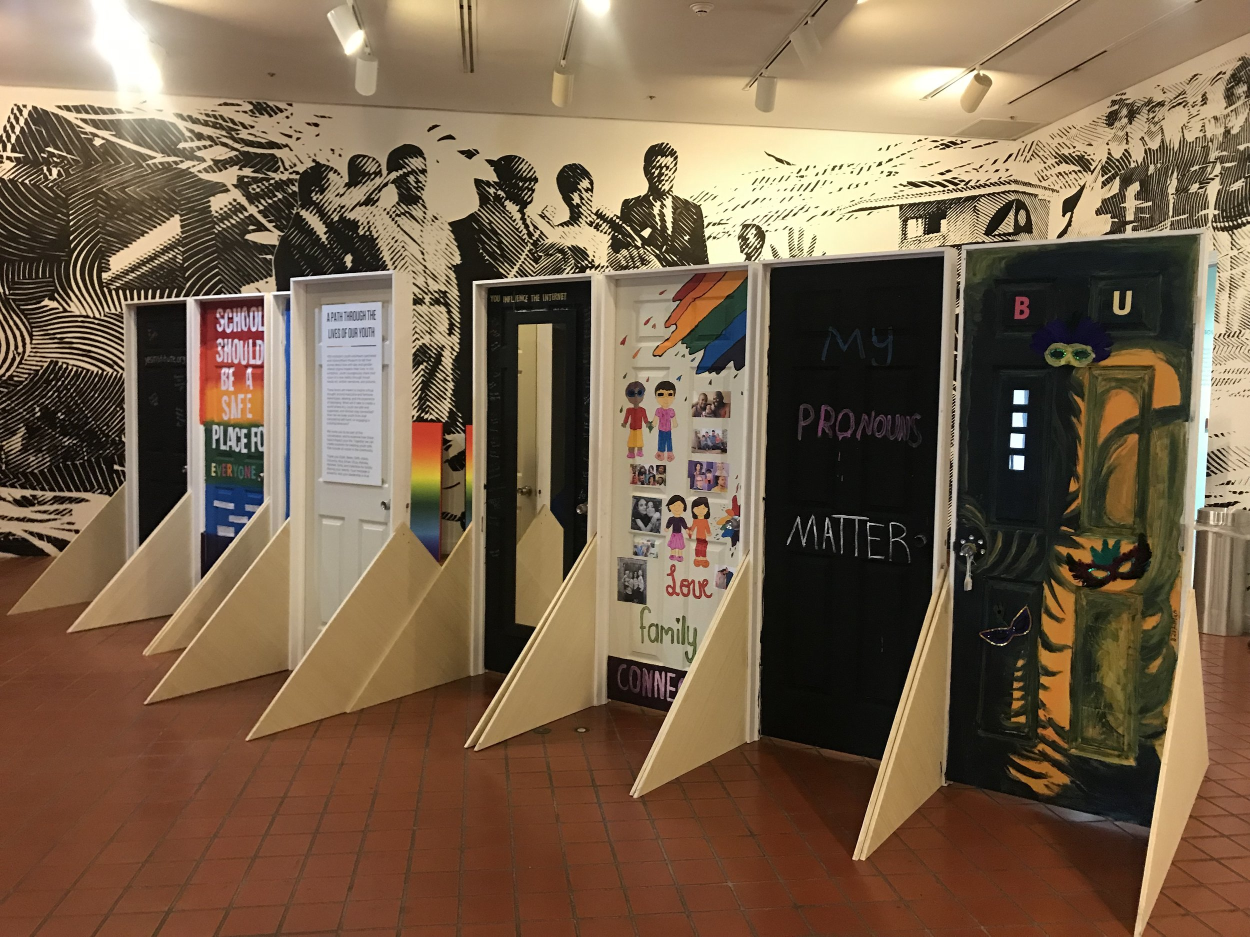 The final doors created by youth for the Queer Miami exhibition.    (Photo: HistoryMiami Museum)