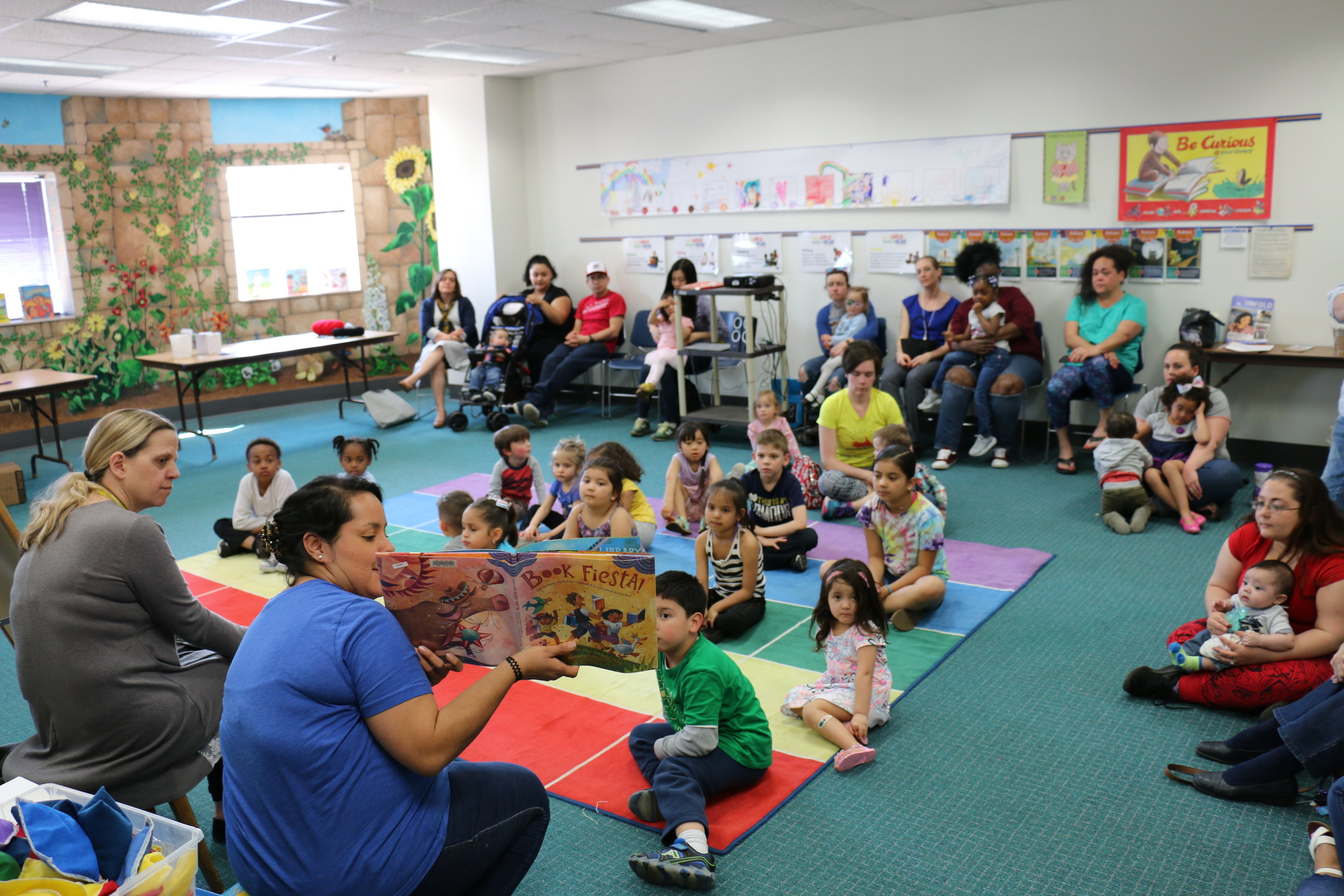 Bilingual storytime on El día de los niños at the Main Library.    (Photo: Melody Lutz, SJCPL)