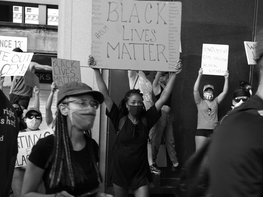 protesters holding black lives matter sign