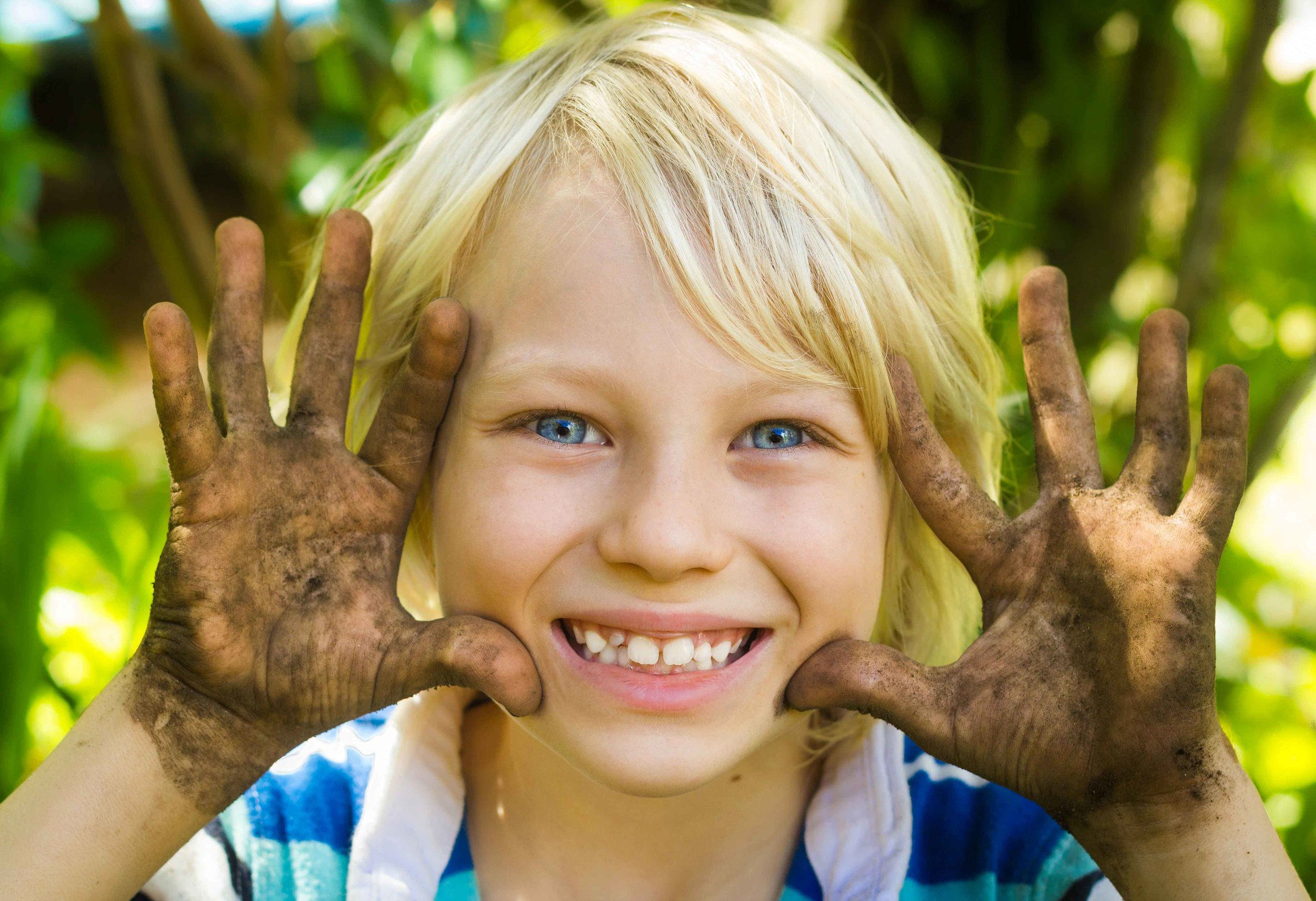 Camps-mud-smiling-kid-for-web.jpg