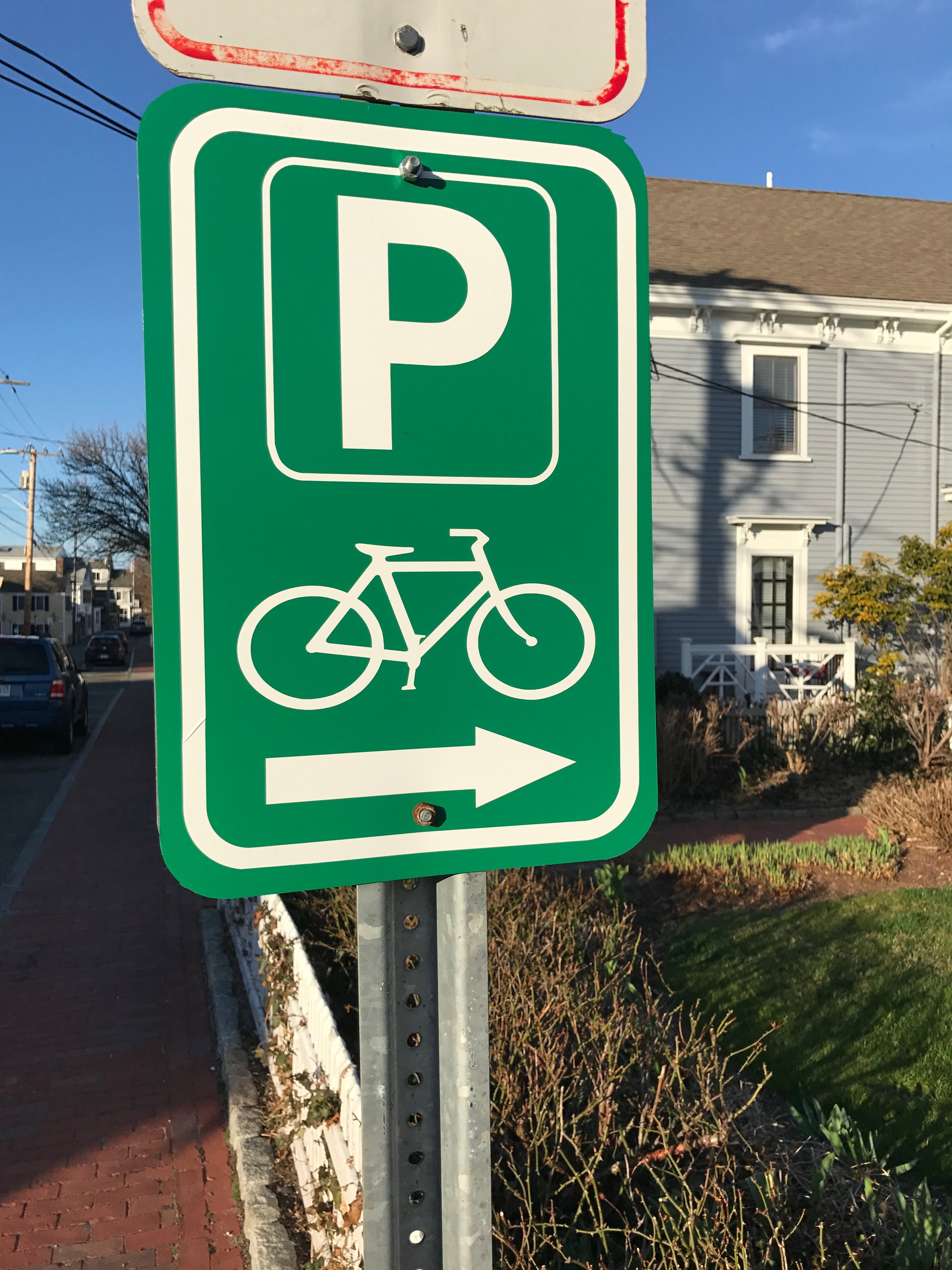 Bike parking wayfinding sign on Commercial Street in Provincetown.