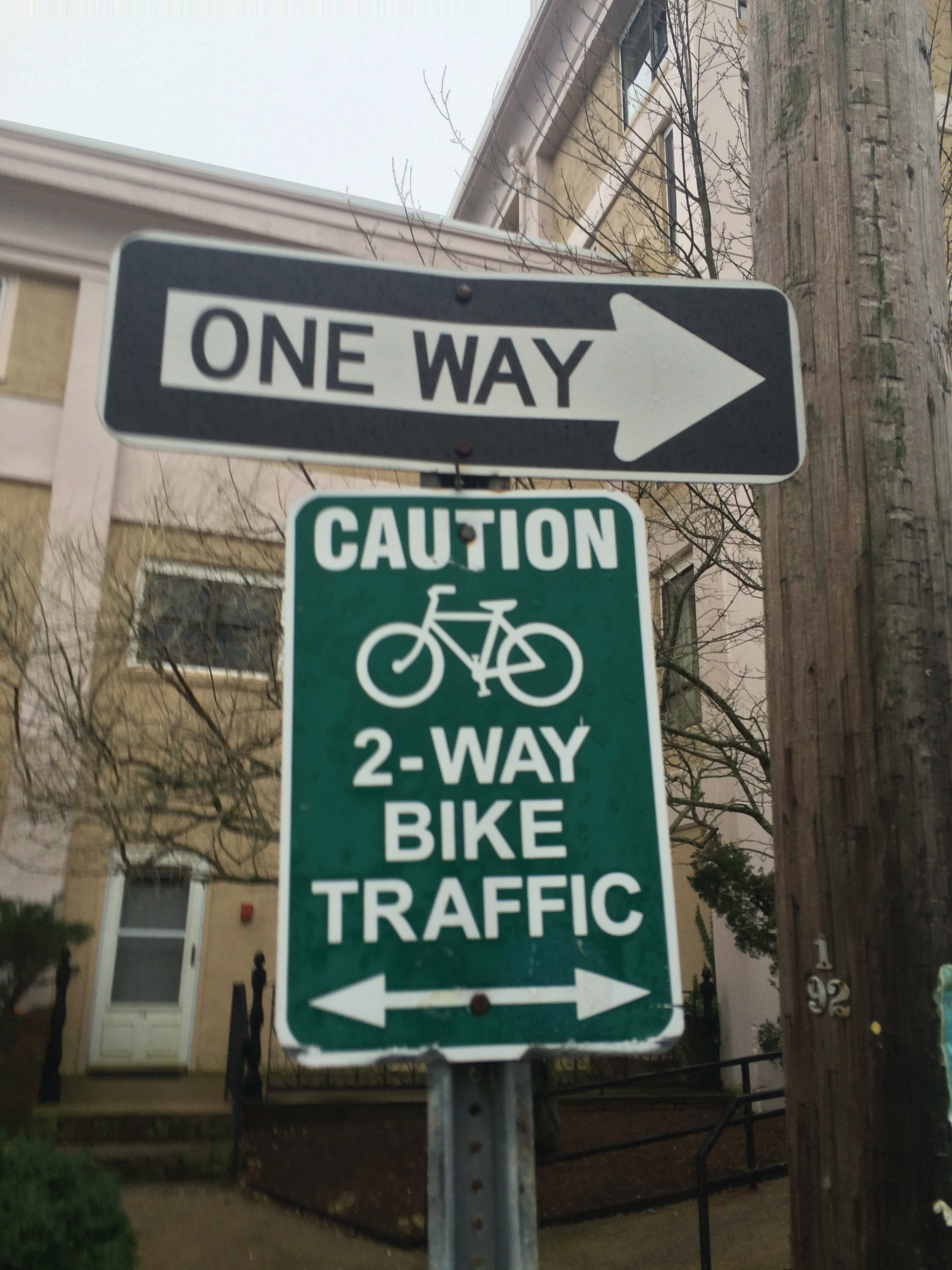 """""""Caution 2-Way Bike Traffic"""" sign on Commercial Street in Provincetown."""