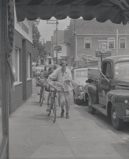 Women walking their bicycles in Provincetown c. 1940