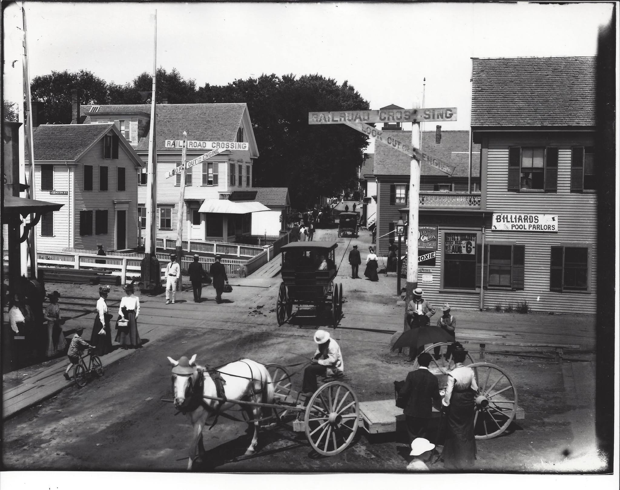 Child with a bicycle on Commercial St & Standish St at the railroad crossing (c. 1900)