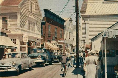 Riding a bicycle on Commercial St circa 1965 - My Grandfather's Provincetown - Lisa King