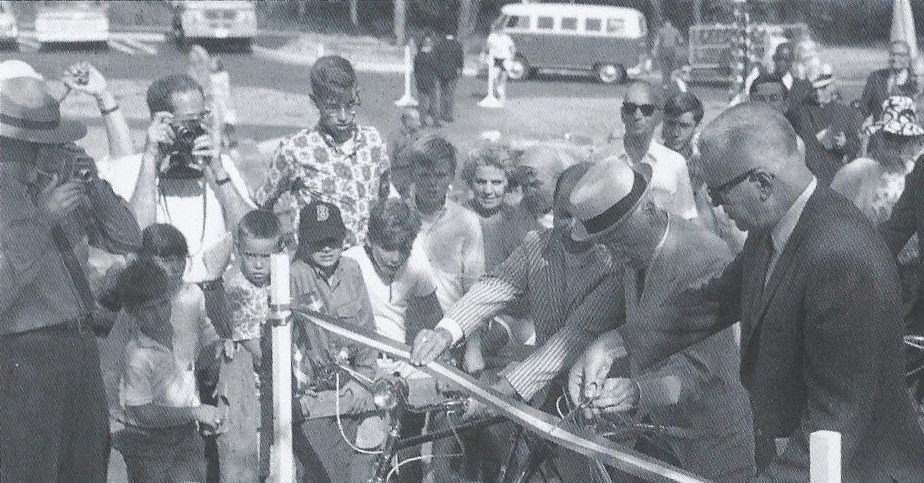 Cutting the ribbon for the grand opening of the Province Lands Bike Trail, Cape Cod National Seashore, 1967