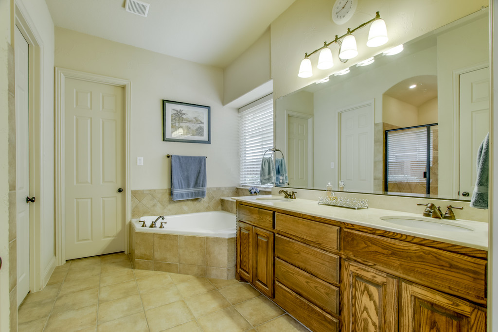 Masterbath features Walk In shower w seating, Tub, Dual Sinks & Big Closet.