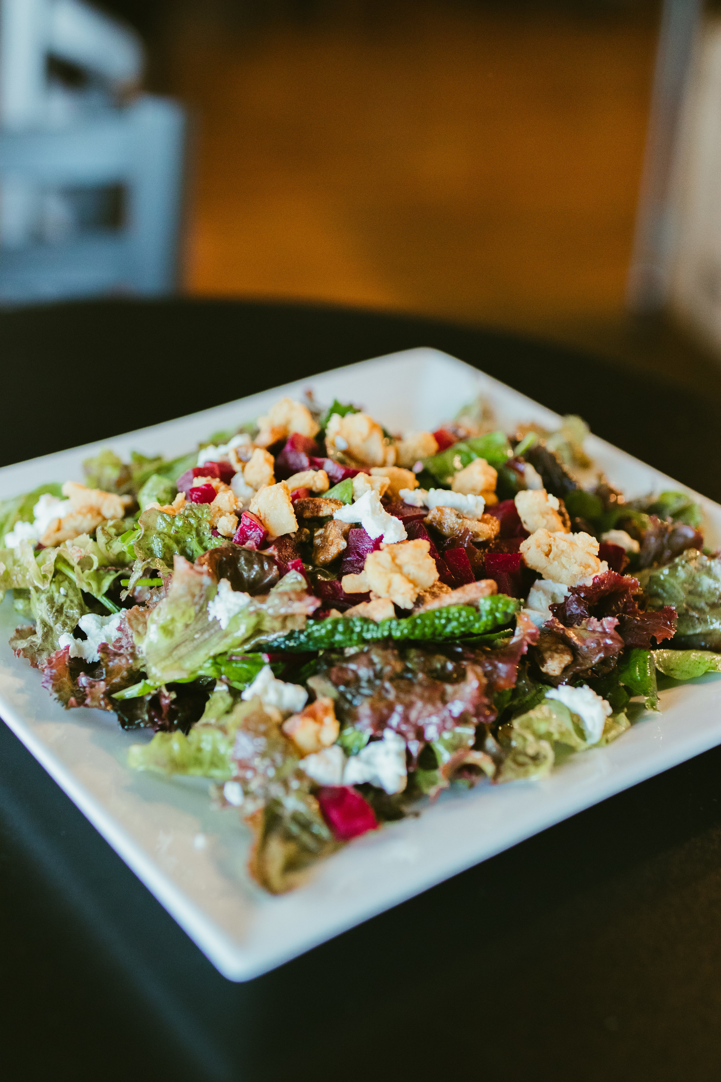 Freshly picked greens with roasted beets, candied walnuts, feta, and pork cracklings