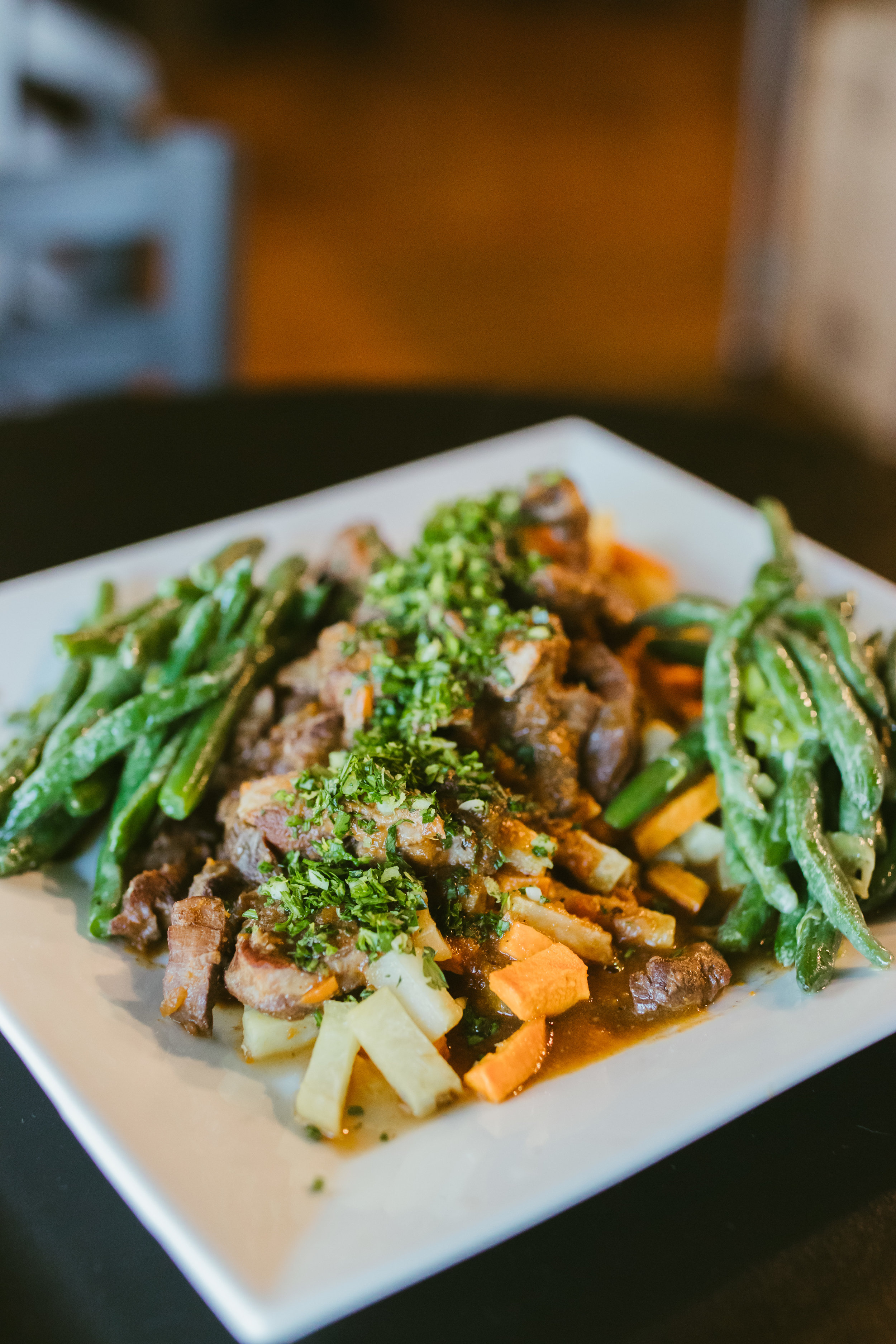 Braised beef shanks with roasted root vegetables and green beans