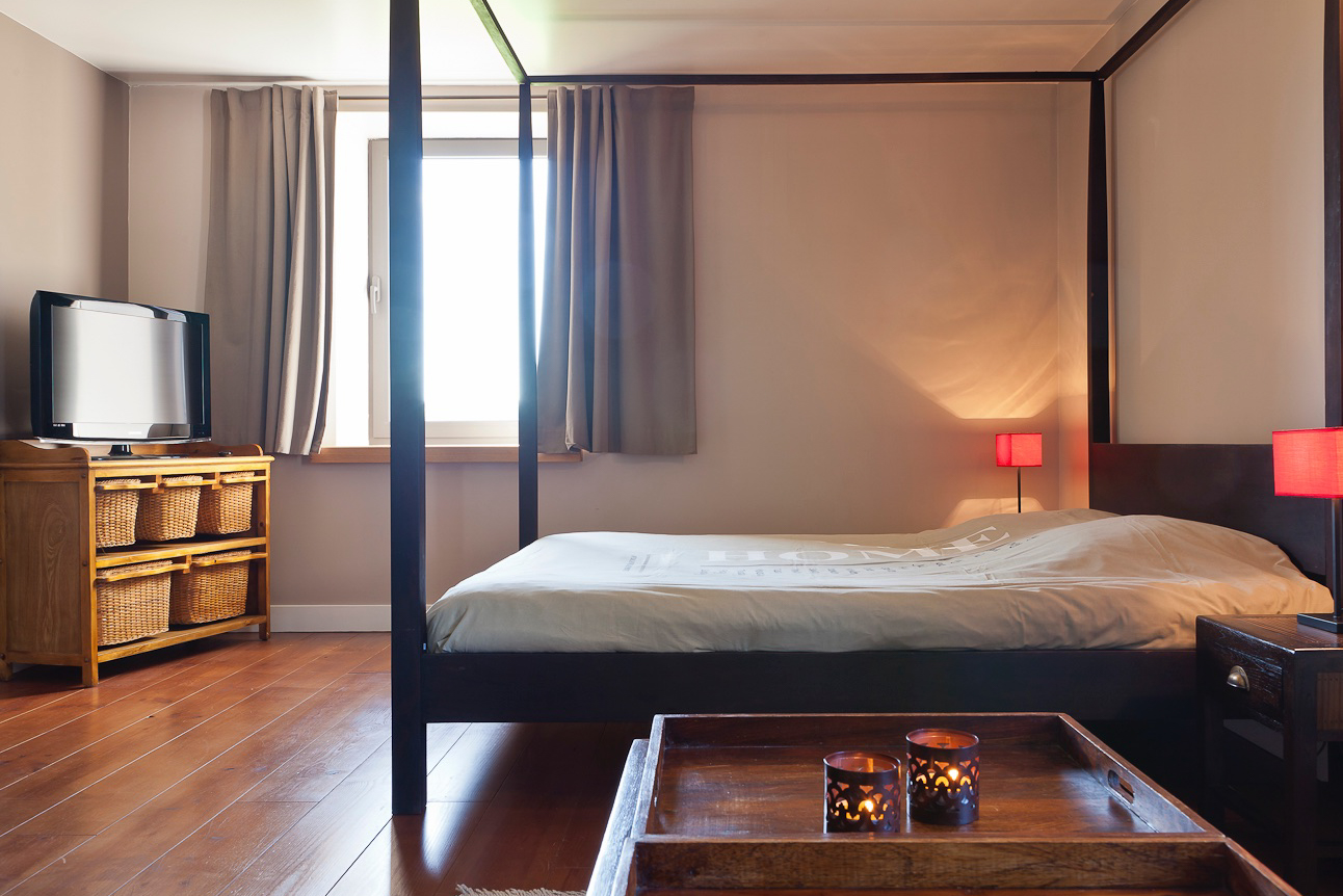 """Bedroom 6 - With bathroom (jacuzzi tub, toilet), a TV and a view on """"le Pays de Herve""""."""