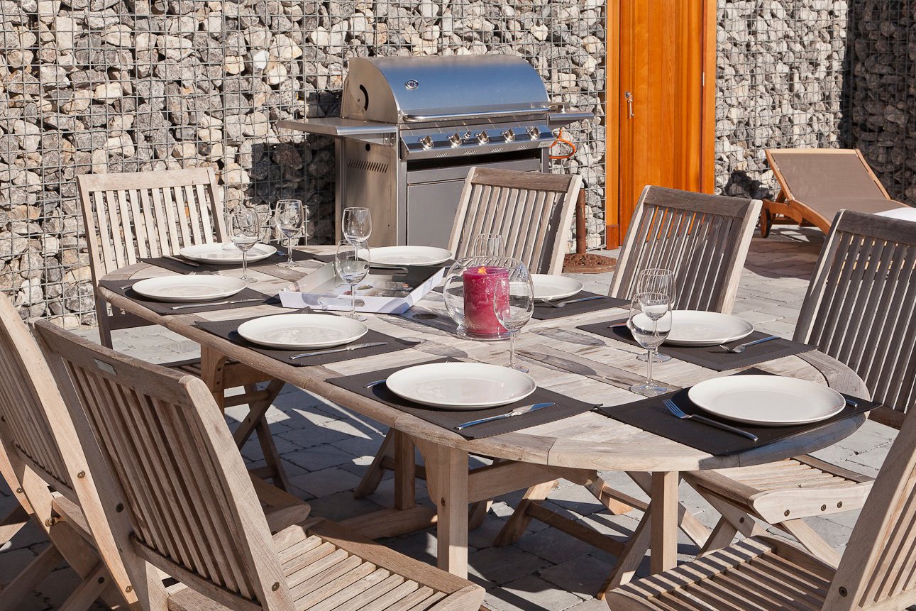Patio - BBQ Area, garden furniture and lounge chairs.