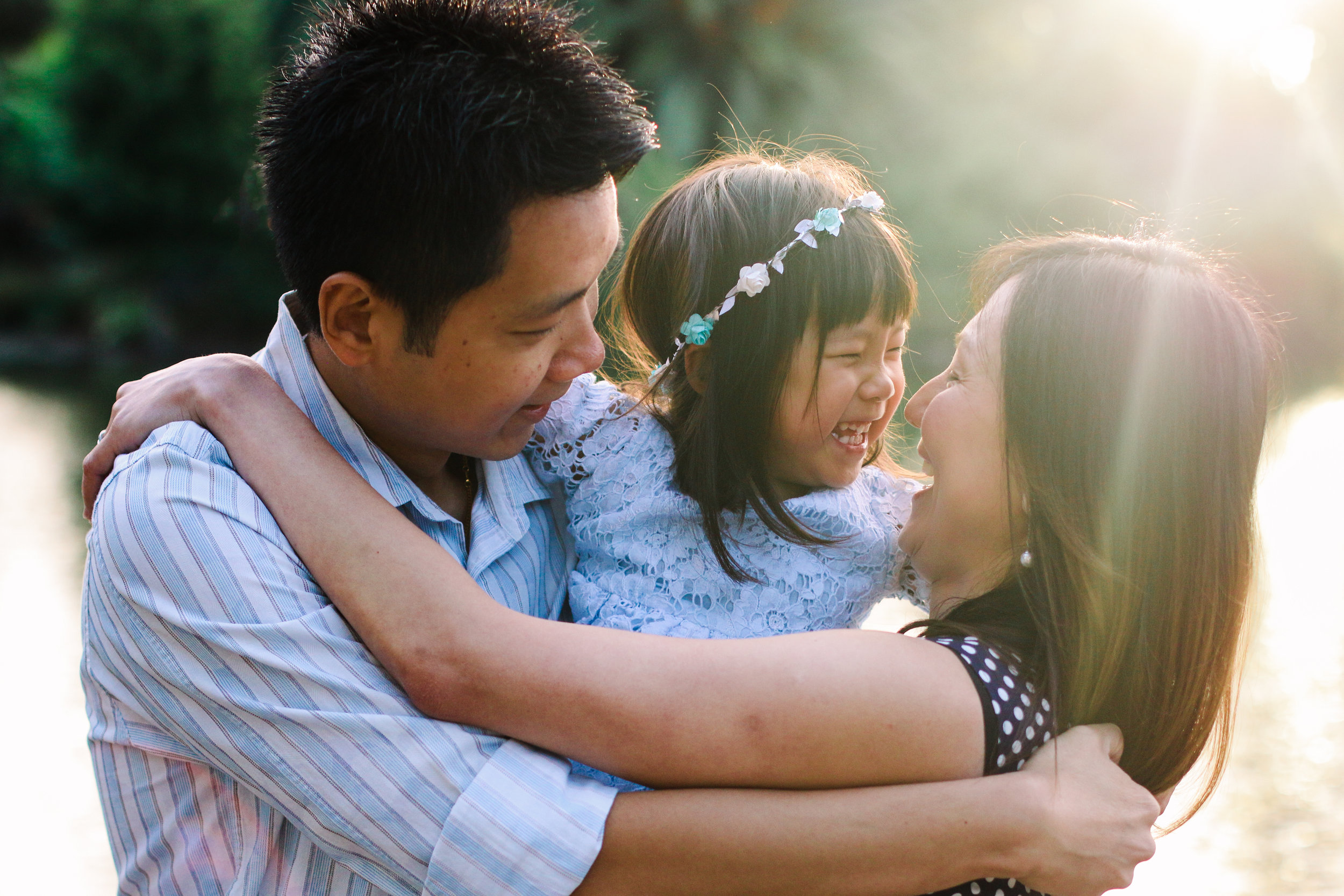 parents hugging daughter-melbourne sunset golden hour photos-2.jpg