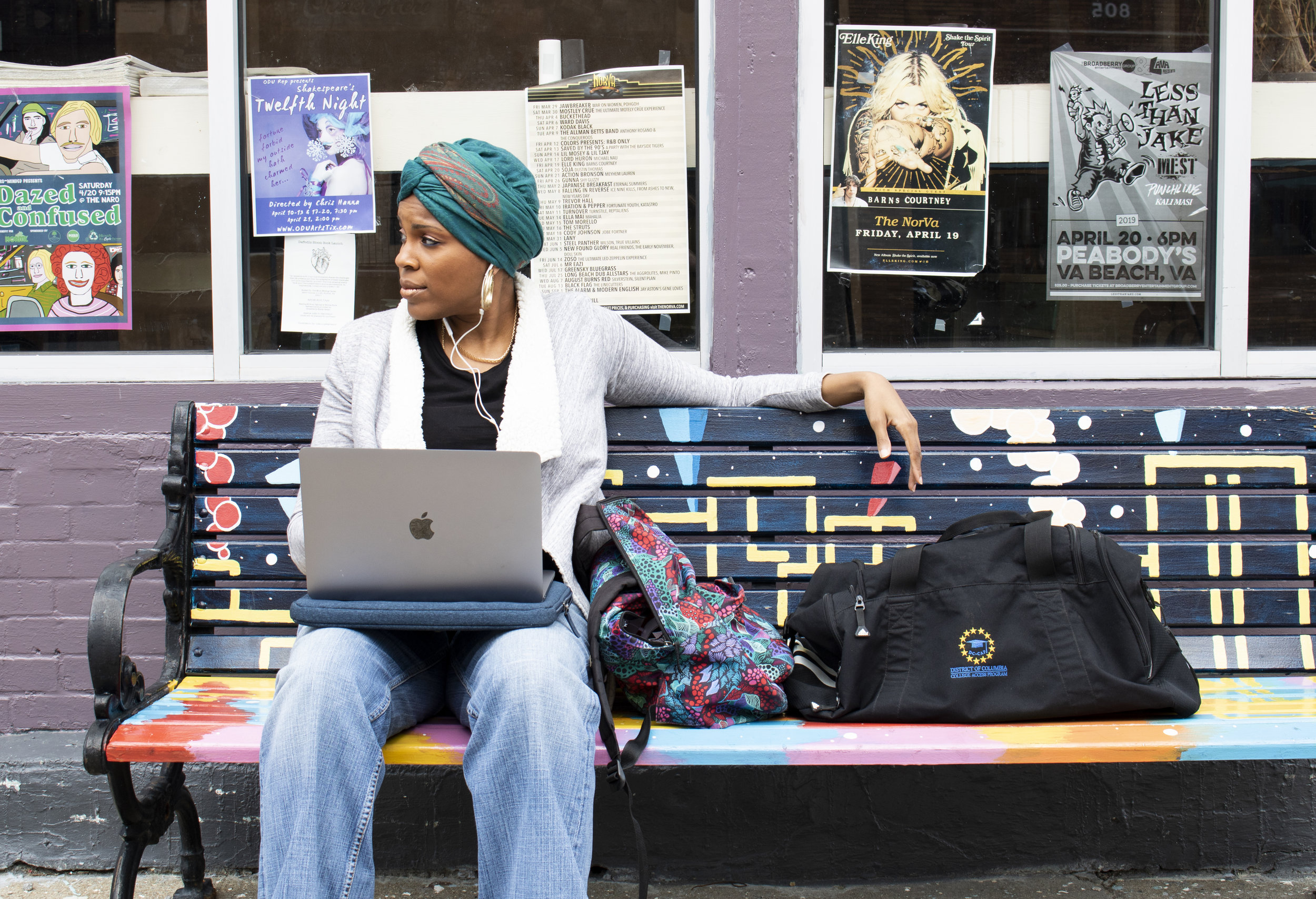 girl-sitting-on-a-bench-with-laptop-computer.jpg