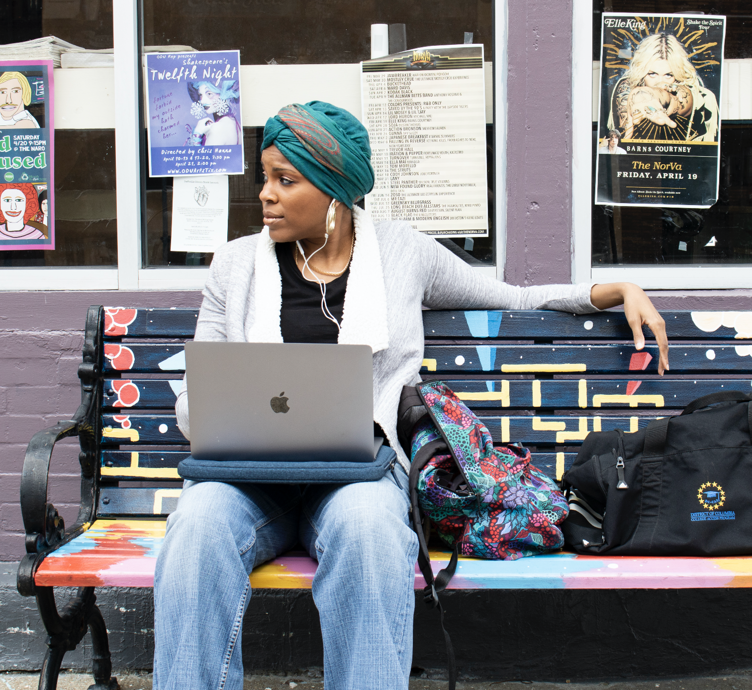 black-girl-with-headwrap-sitting-on-bench-with-laptop-computer-puckn-khaos