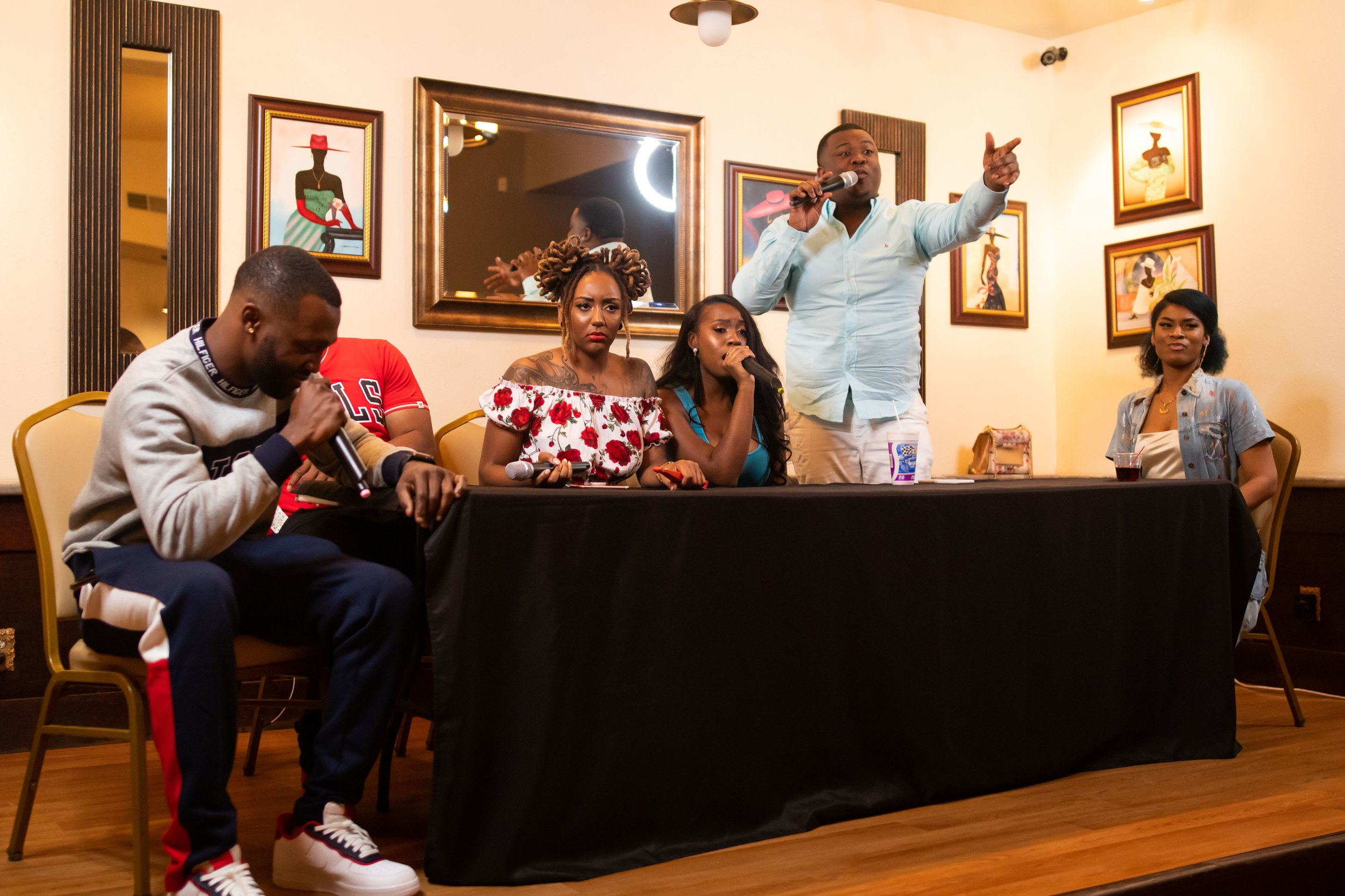 Things got interesting with the Cast of Authenticity during their first live show.  Photo Credit:  Phillip Ellington