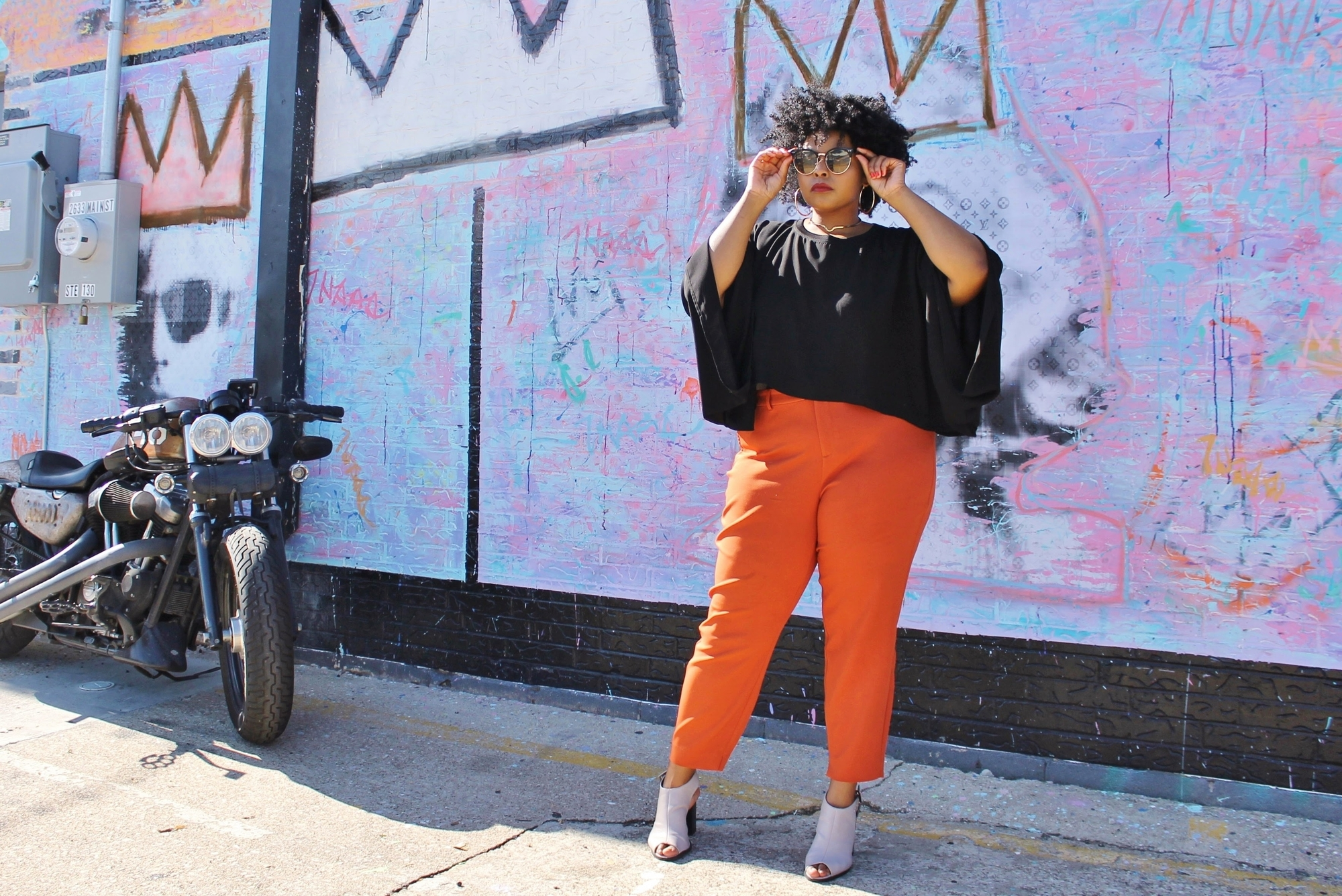mommy blogger adjusting sunglasses
