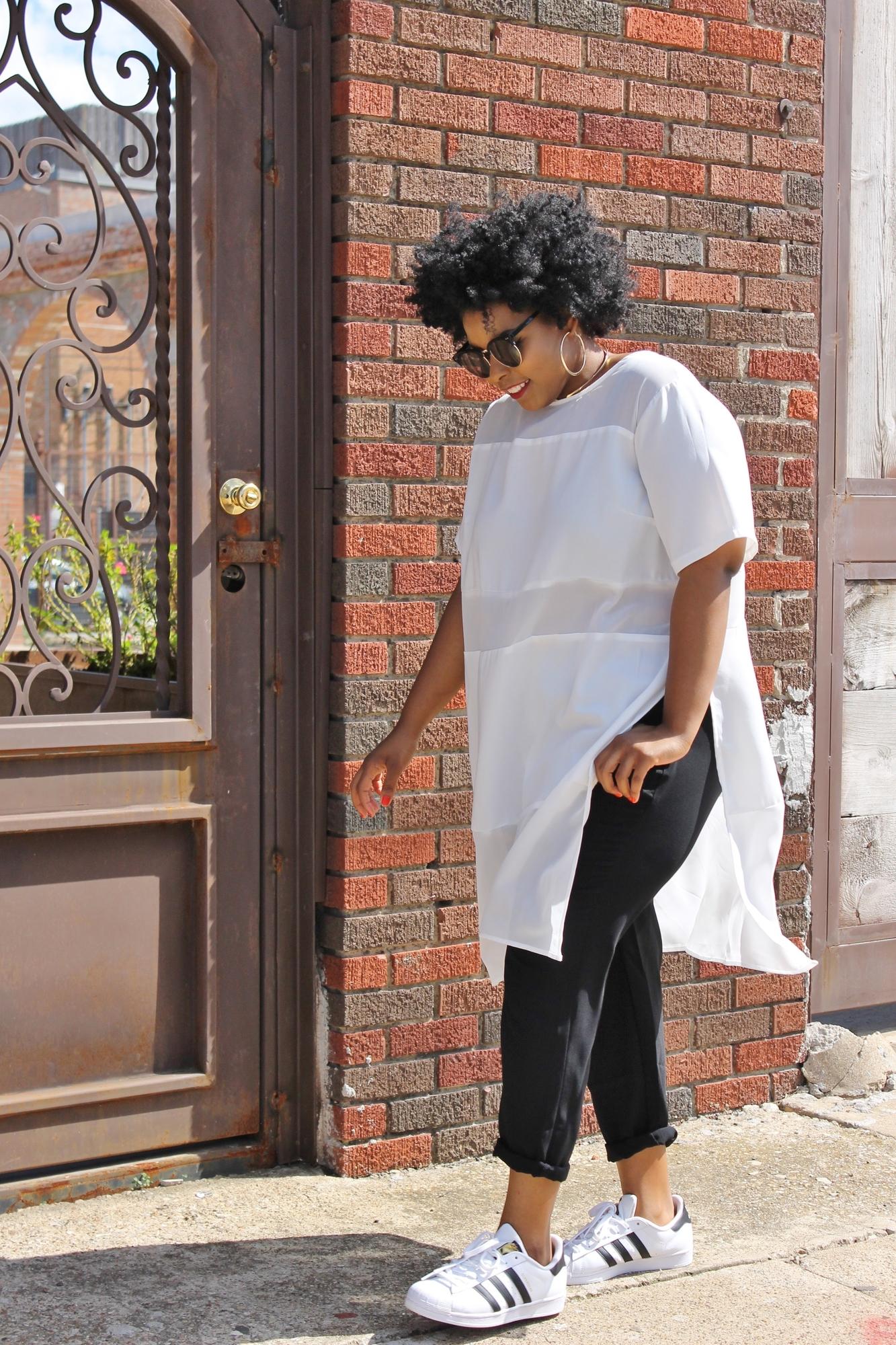 black style blogger walking in white dress