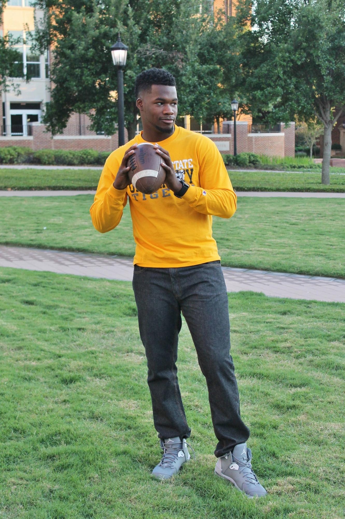 african american throwing football