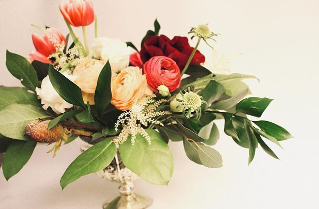 "VDAY PETITE | 20 stems of assorted blooms, greens and berries. The perfect way to surprise someone special and say ""I love you!"" The petite arrangement comes with a 6x5 mercury compote vase, free delivery and the option to include a handwritten note."