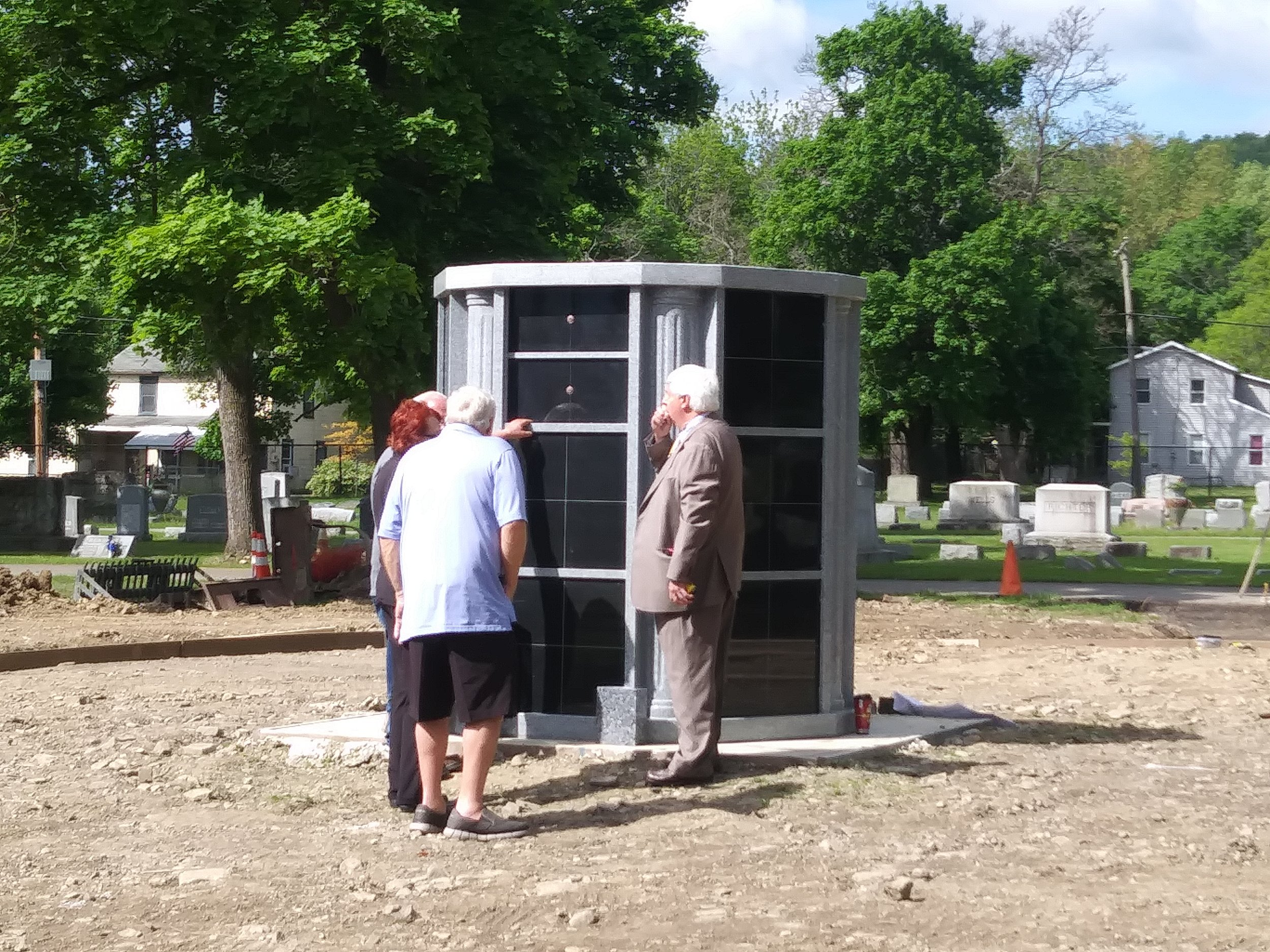 May 24th, the first placement of ashes in the Columbarium. The ashes are those of the Baynes Family, Walter, Helen and son, Christopher. Pictured are Winifred Baynes Burnham, husband Daniel Burnham and Funeral Director Jim Lynch from Lynch's Funeral Home.