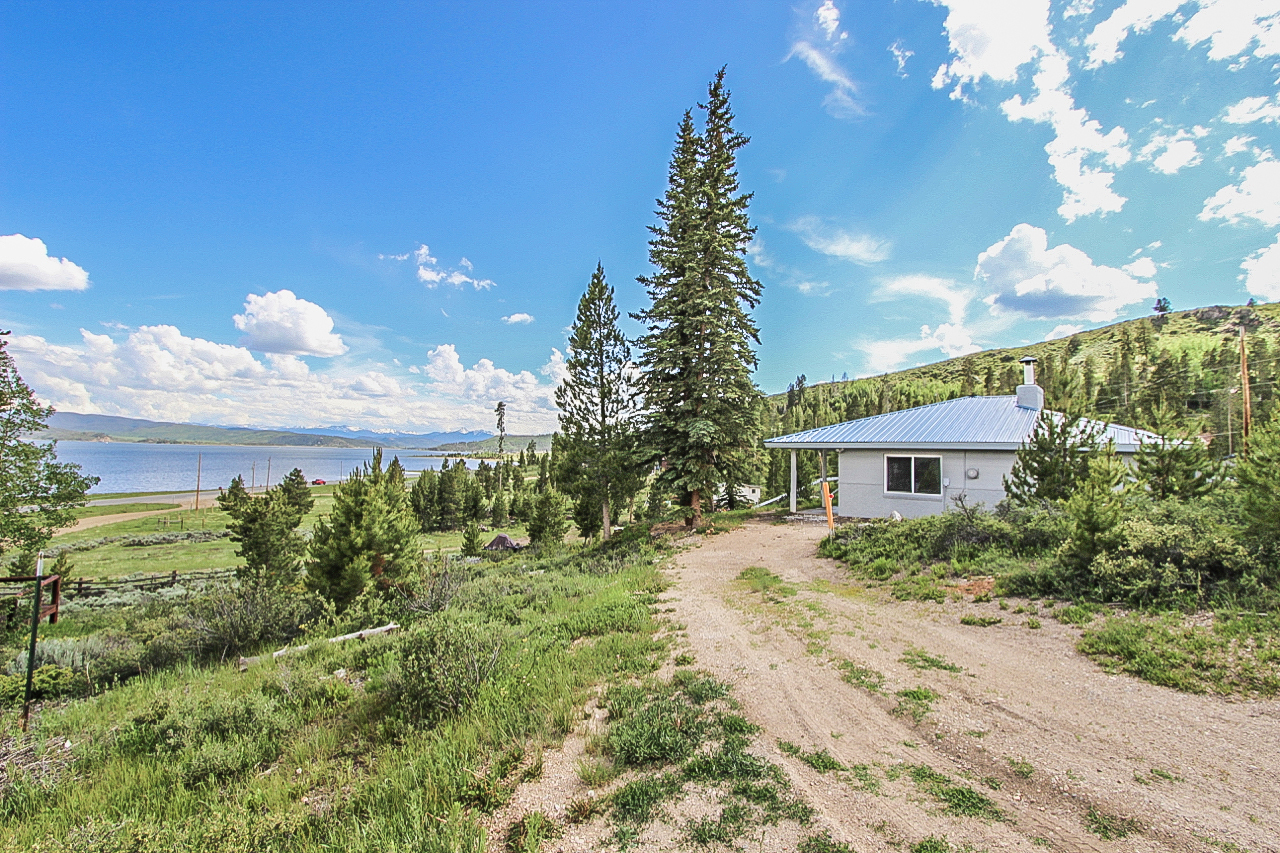 99 County Road 424 - GRAND LAKE - Spectacular lake views for under $400K! Don't miss this great 3 bedroom home with lovely hardwood floors, remodeled kitchen and bathrooms, dining area, huge fireplace, and fantastic views of Lake Granby from the front porch. Listed for $369,000