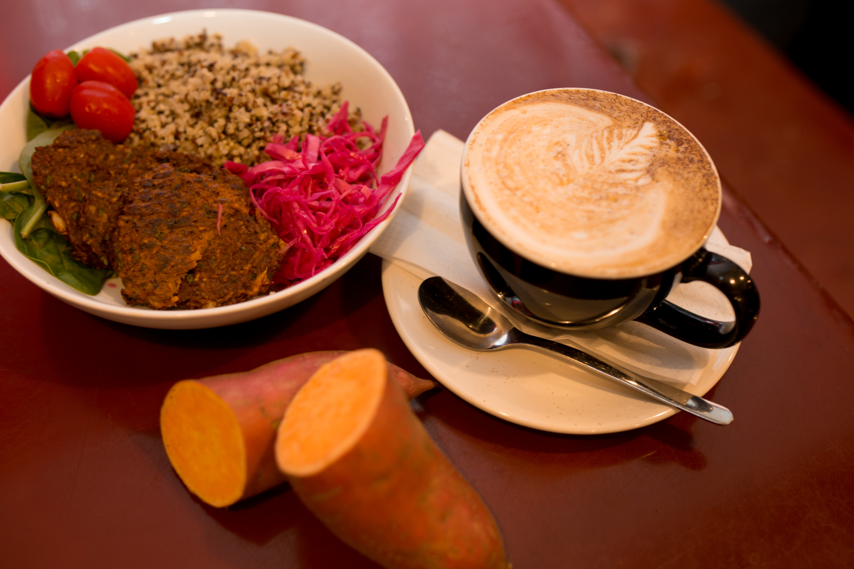 The  Harvest Bowl , featured at  Rabbit Dash, is spinach, quinoa, tomatoes, red cabbage and Sweet Potato Fritters with chipotle mayo! Pictured here with a toasted marshmallow latte.