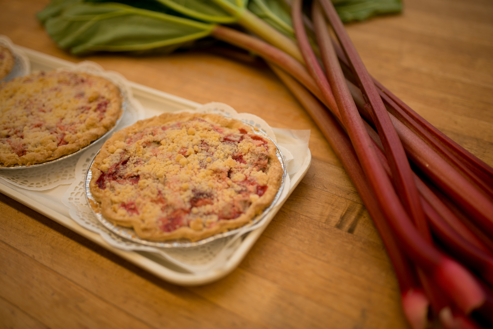 I love the tartness of rhubarb baked into squares, tarts, cakes and of course – pies!