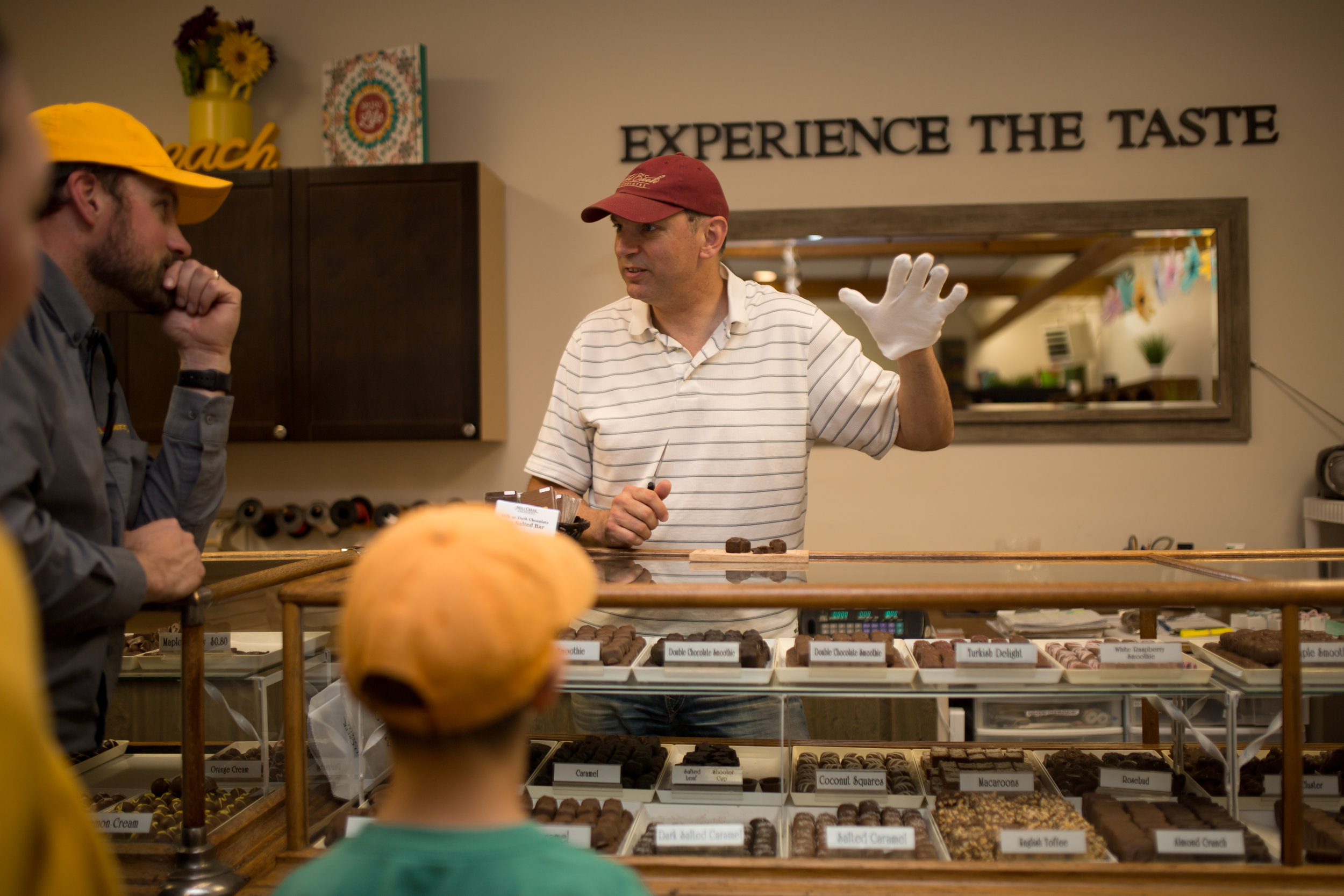 Paul Becker explains the chocolate making process behind the counter at  Mill Creek Chocolate's  retail outlet in Port Elgin.