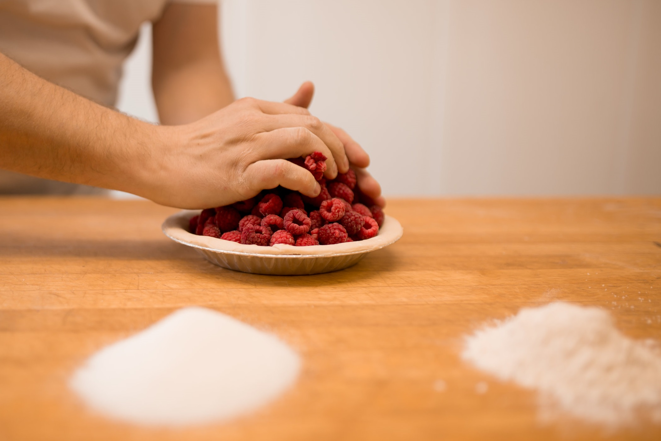 Justin Niklaus of  Offshore Bakery  makes a pie using frozen  Hi-Berry Farm  raspberries.