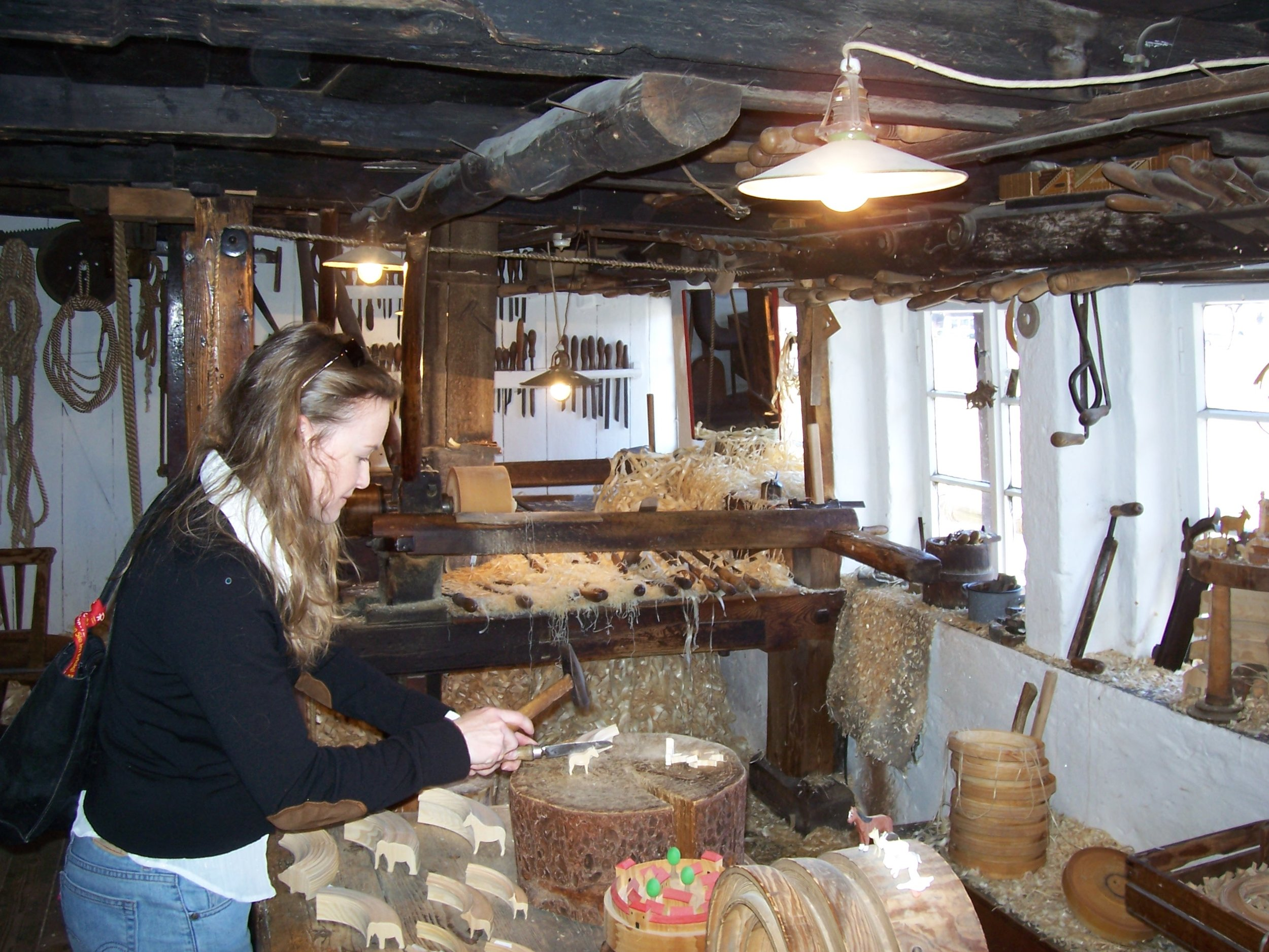 Loreen trying her hand at reifening in the Living History Museum in Seiffen