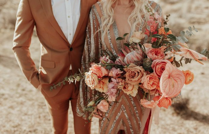 Beautiful portrait of bride and groom celebrate wedding with local and organic peach bouquet of flowers outdoors in summer