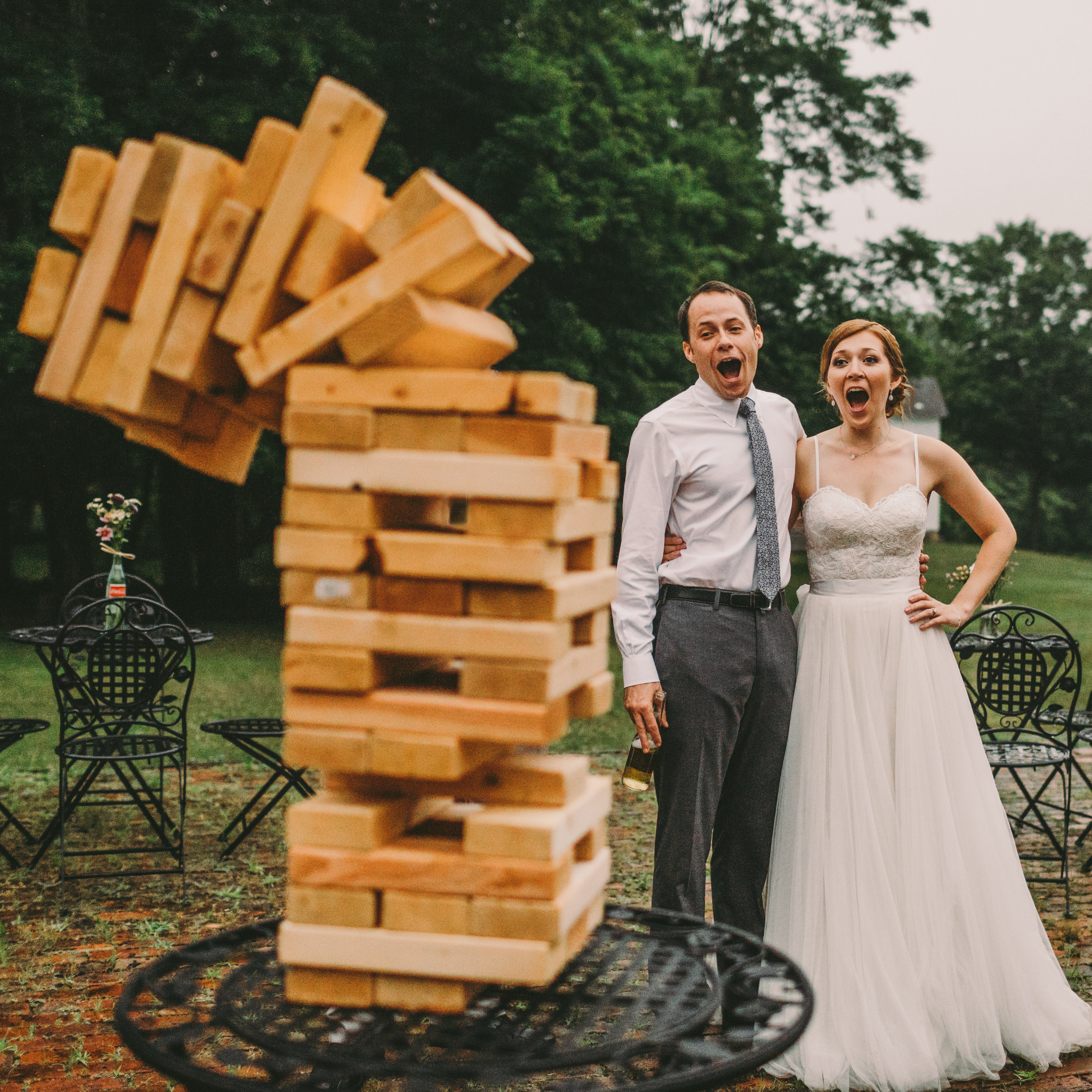 Bride and Groom playing Jenga at their rustic waterloo village wedding in Stanhope, New Jersey