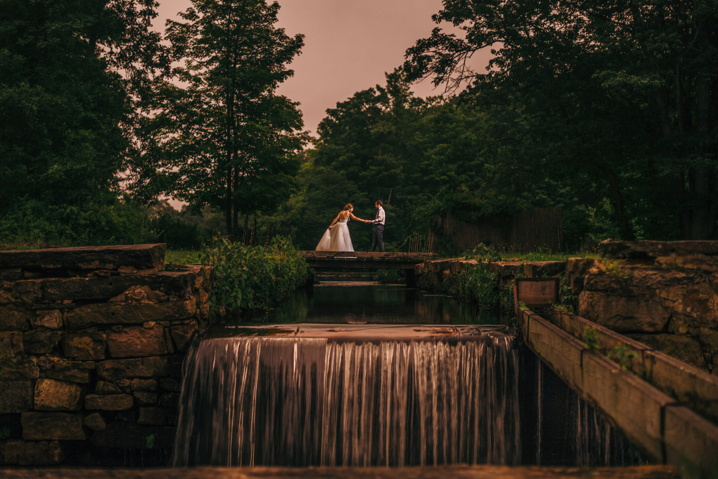 Golden hour photos with bride and groom at waterloo village in Stanhope, NJ